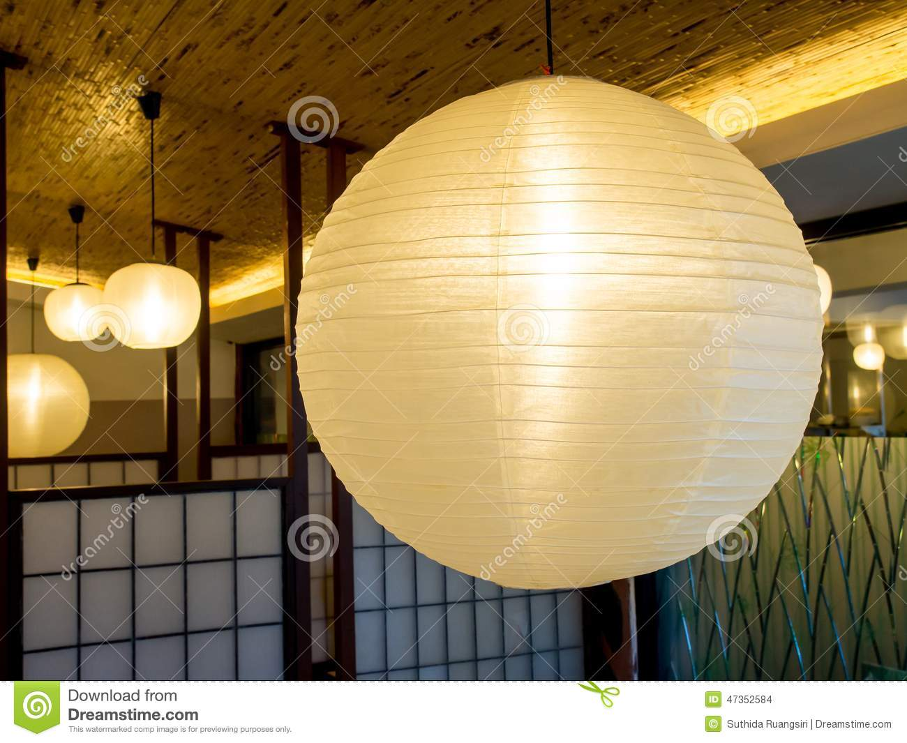 White paper lanterns with lights - Warmly Colored Balloon White Paper Lanterns Hanging From The Ce