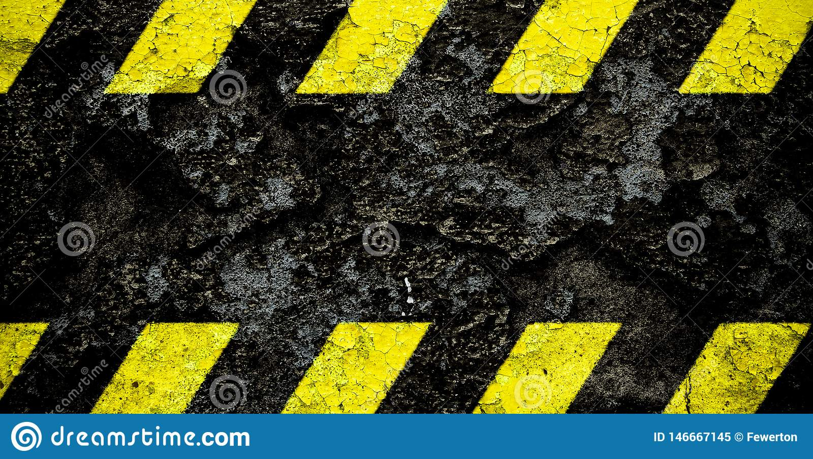 Warning danger sign yellow and black stripes pattern with black area over concrete cement wall facade peeling cracked paint.