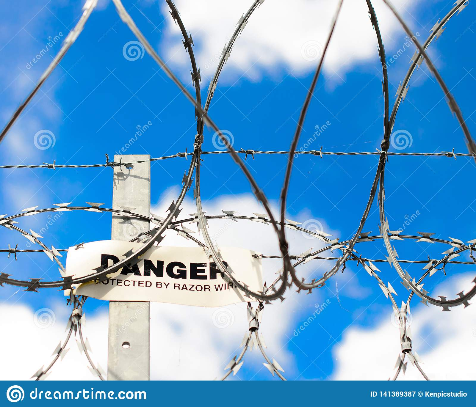 Warning sign and barbed wire