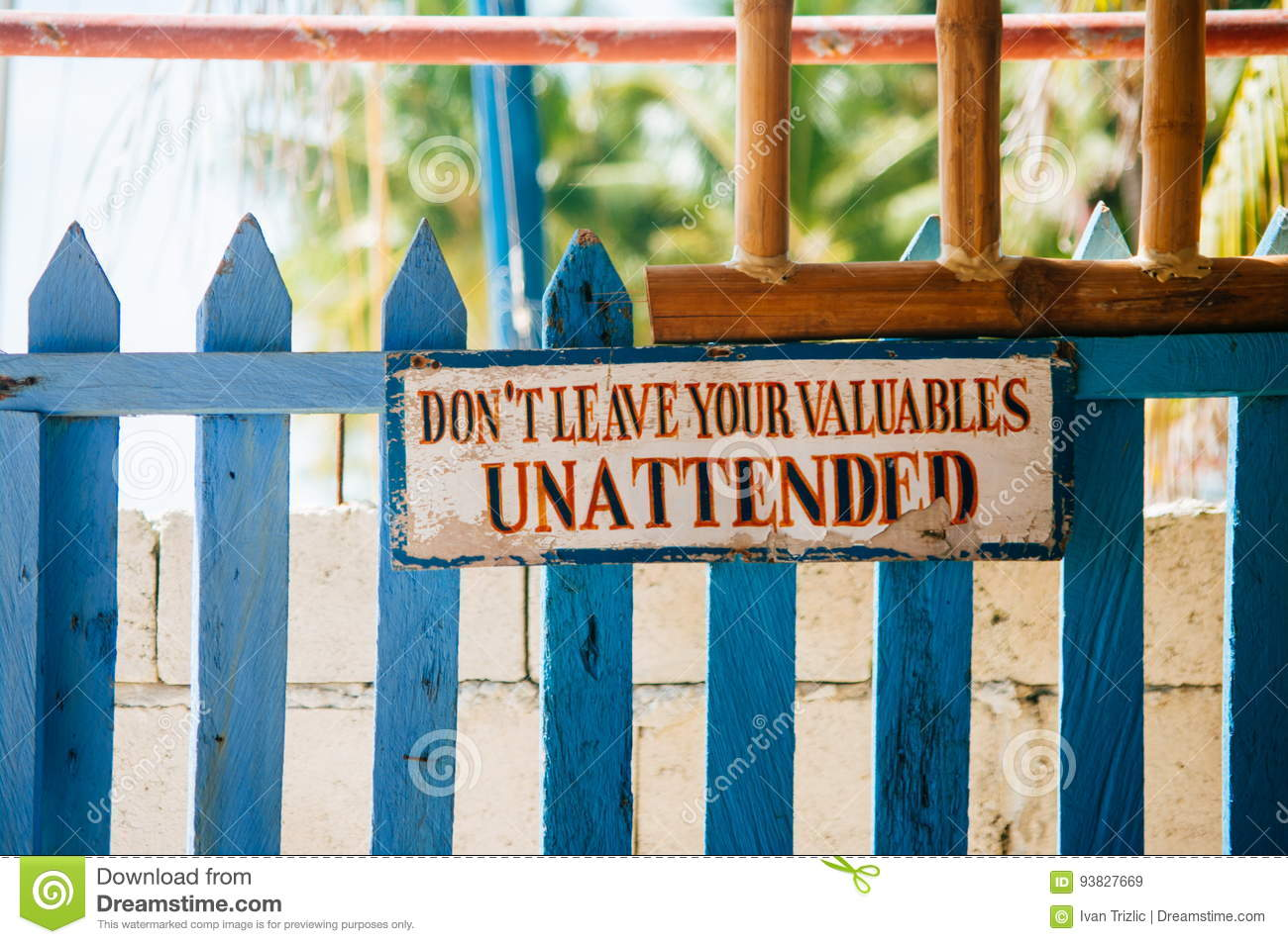 Warning Sign Board Hanging On The Wooden Gate: Don`t Leave