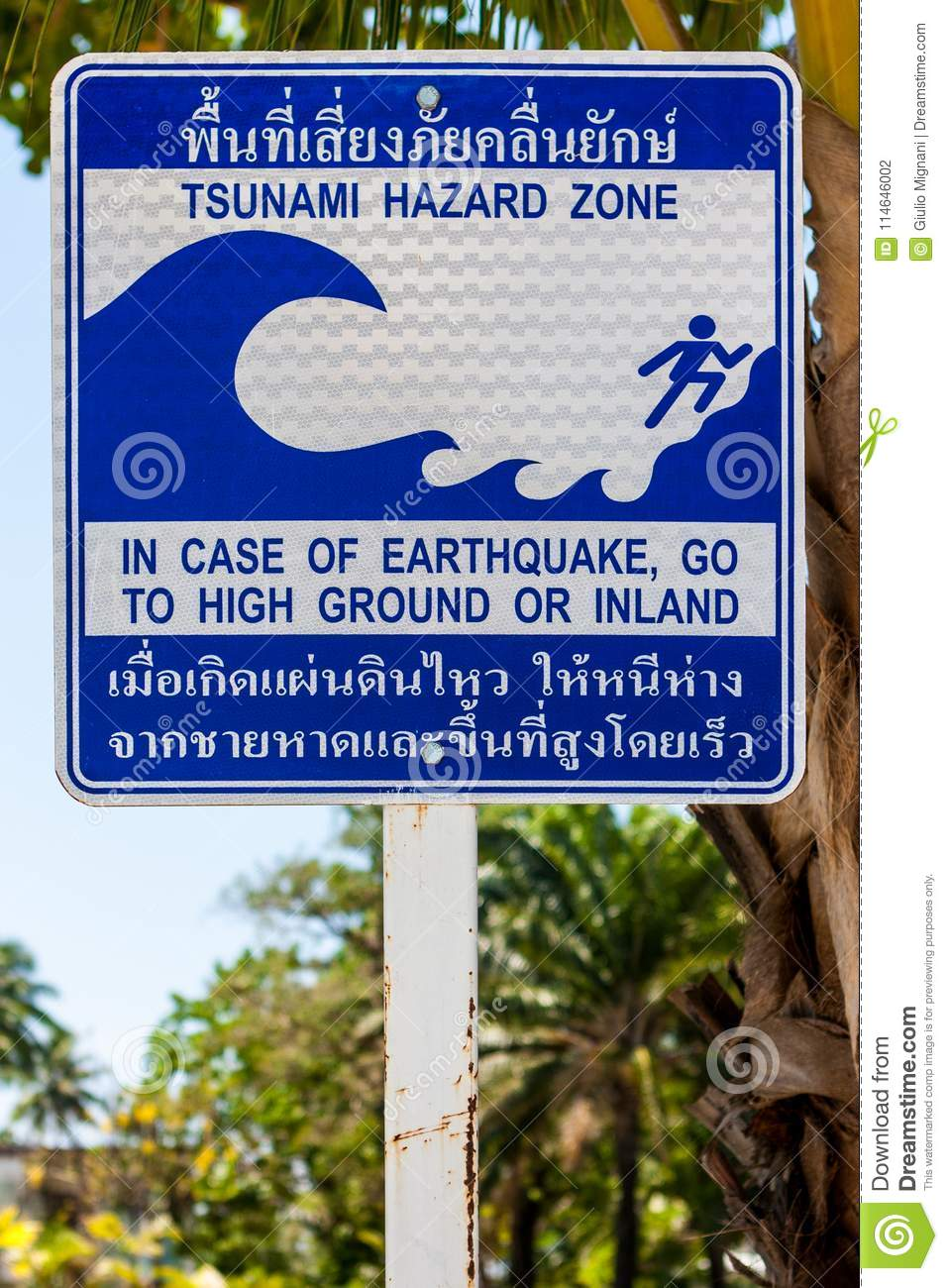 Sign indicating the evacuation route in case of a tsunami. Phi Phi Island, Thailand.