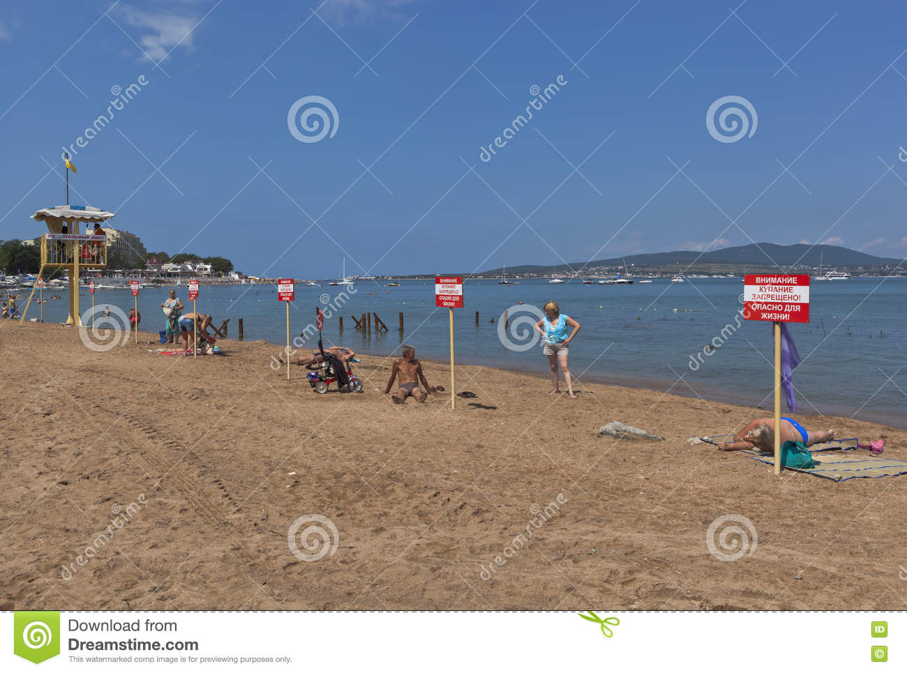 Warning signs with the inscription Warning! No swimming! Danger to life on the beach in Gelendzhik
