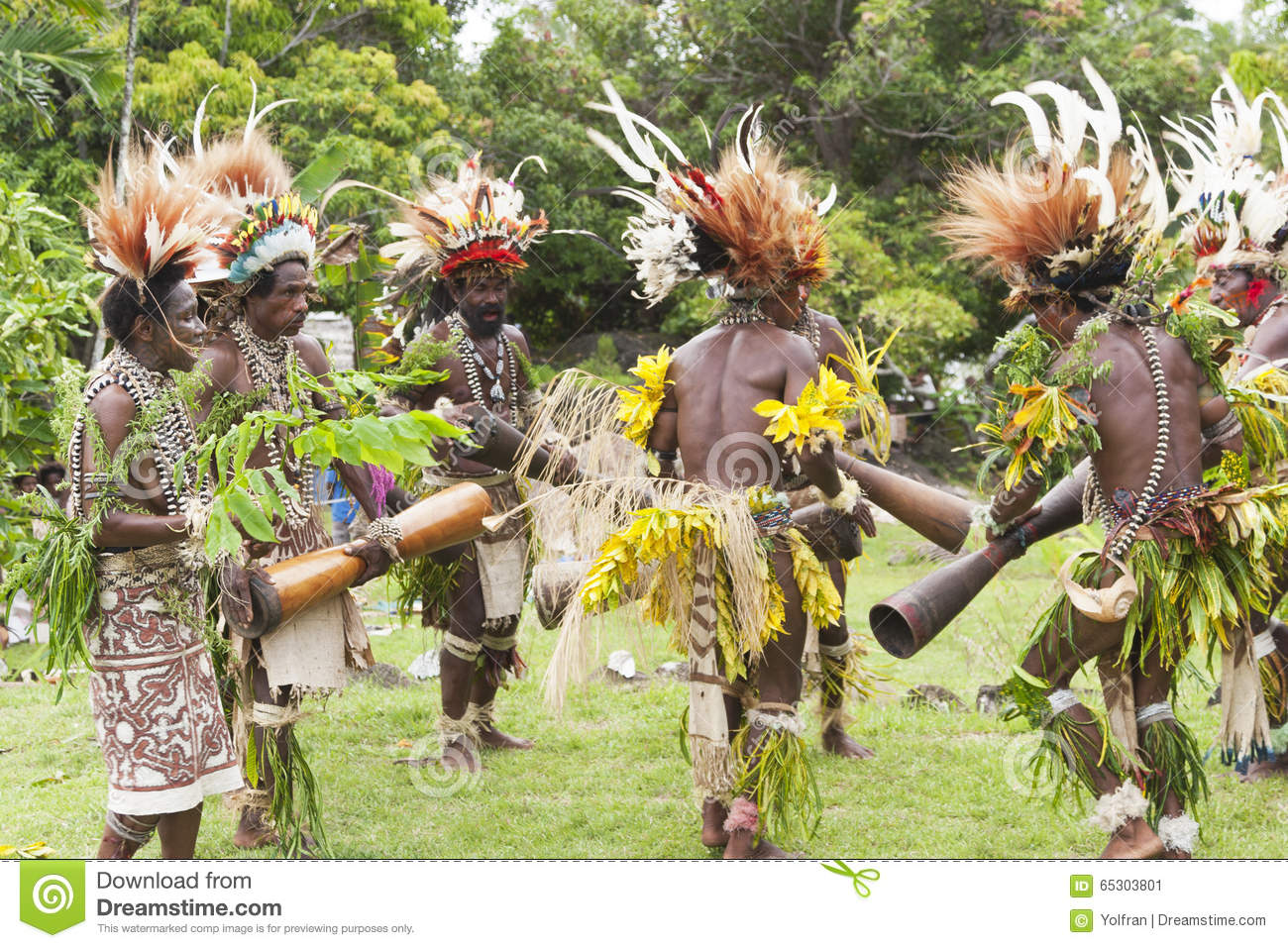 Warrior tribe dancing in tropical rainforest village