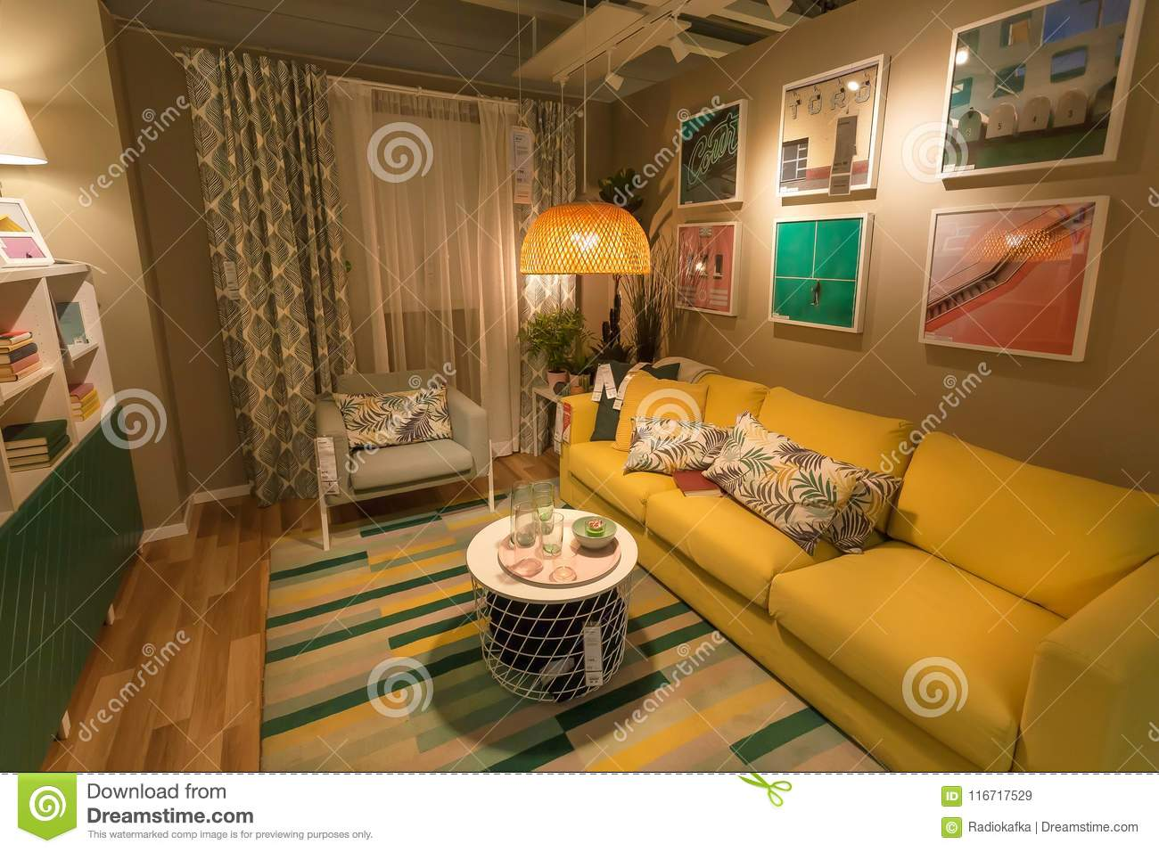 Cute modern living room in large ikea store with sofa furniture decor lamps