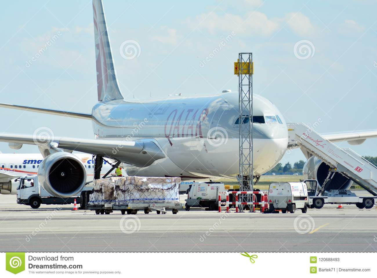 A7-AEC Qatar Airways Airbus A330-302 . The plane at the airport on loading at the airport in Chopin airport