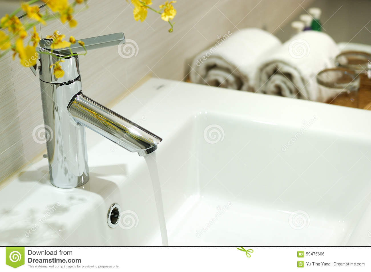 Washbasin and faucet with water drop at home.