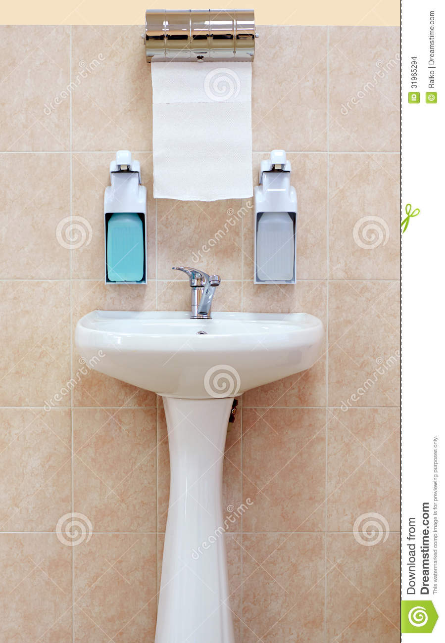 Washbasin With A Paper Towel And Liquid Soap Stock Images
