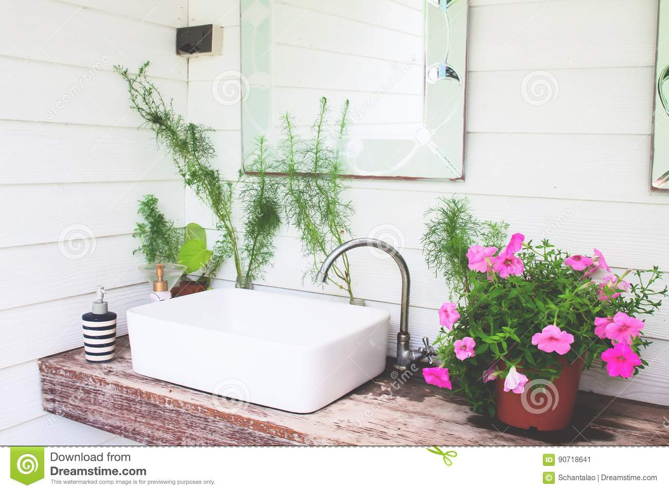 Washbasin with pink flowers in home garden, White and beautiful