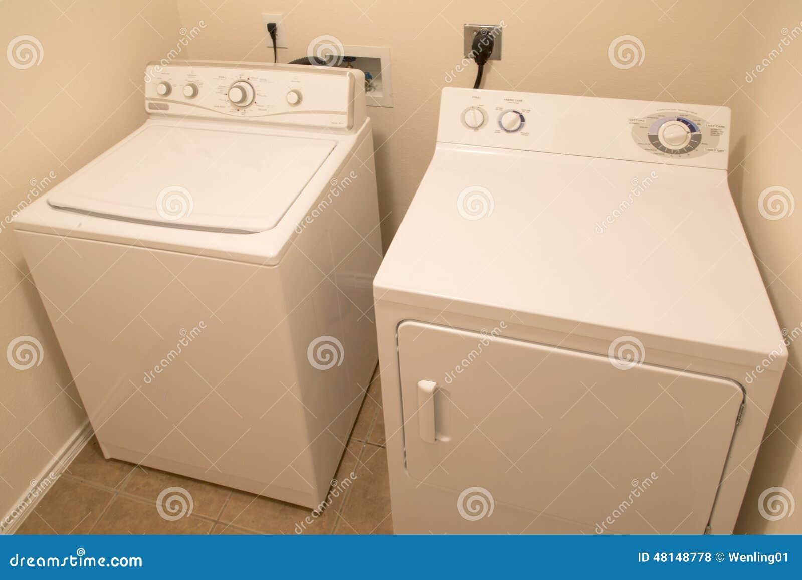 Washer and dryer in washroom background