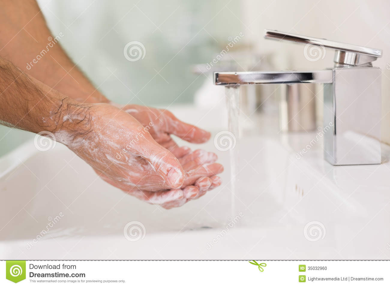 Washing Hands With Soap Under Running Water At Bathroom Sink Stock ...