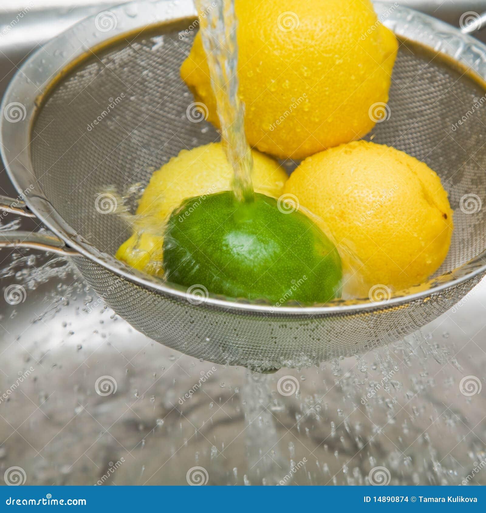 Washing Lemons And Lime Stock Images Image 14890874