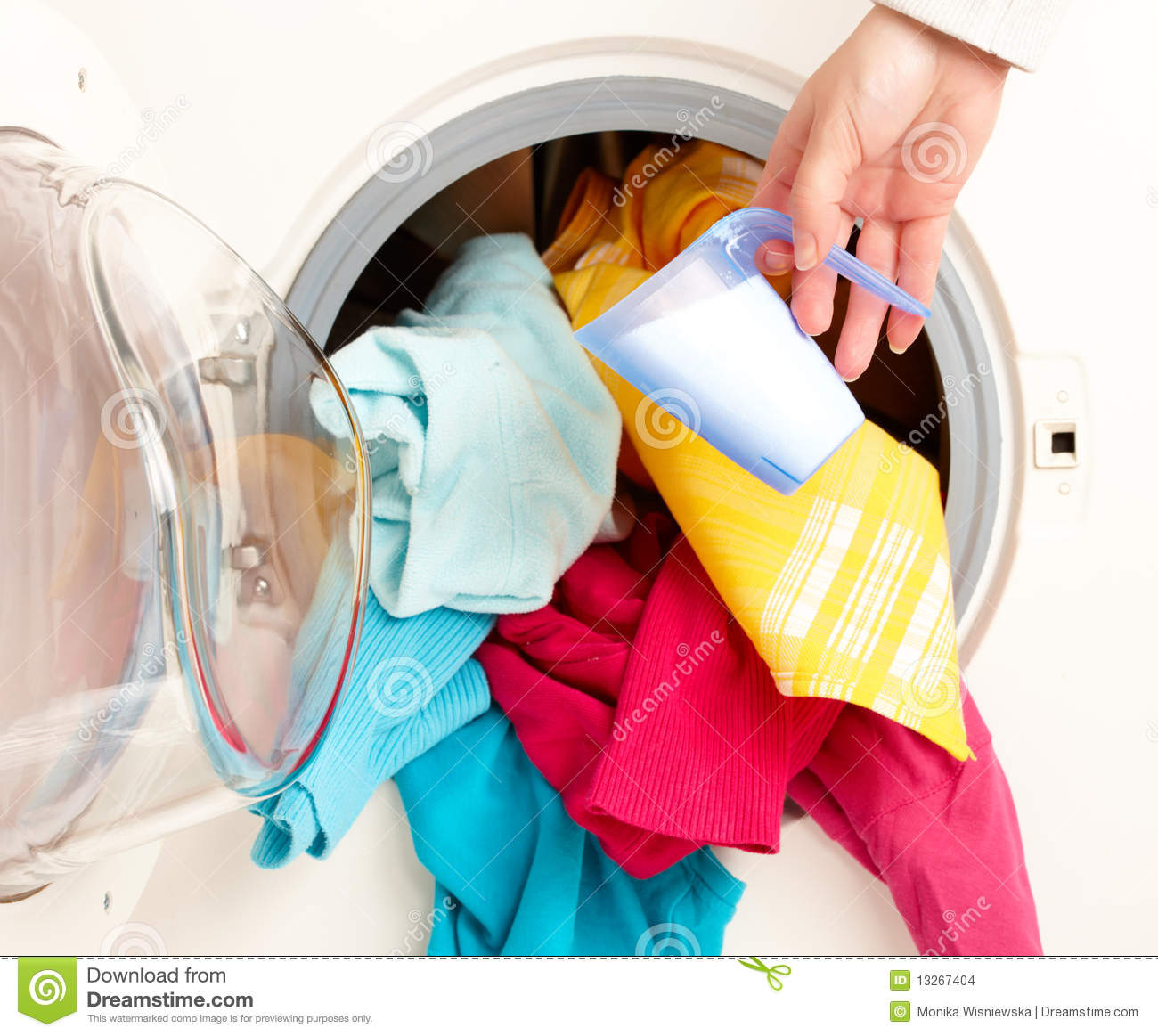 Washing Machine With Clothes ~ Washing machine with colorful clothes stock photo image
