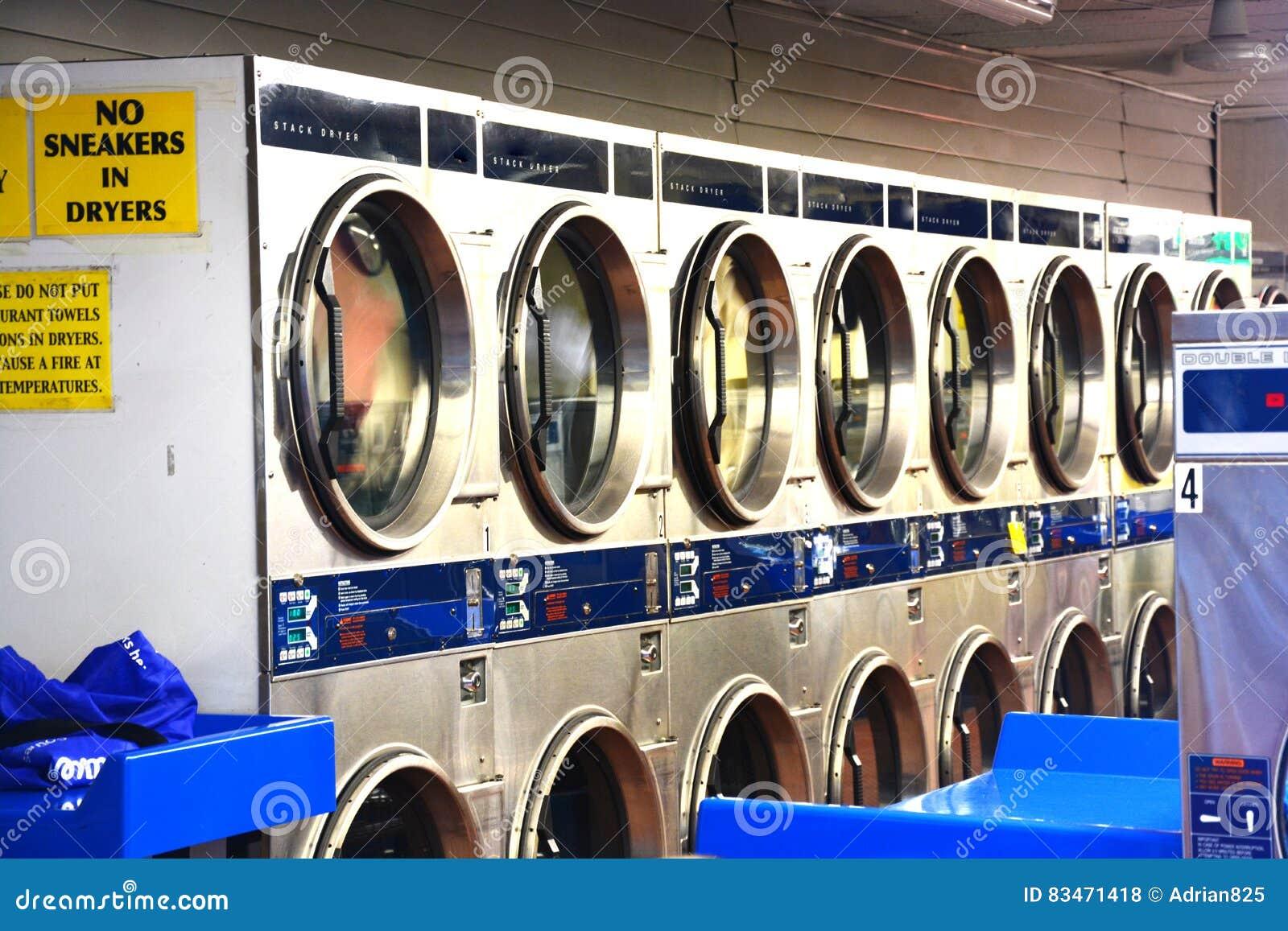 Washing Machines Inside Laundry Shop Or Launderette Stock