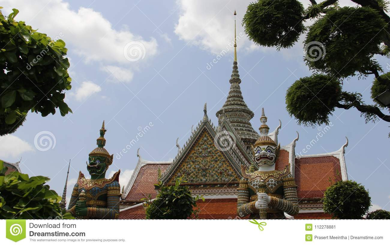 Wat Arun Temple And Giants Guarding