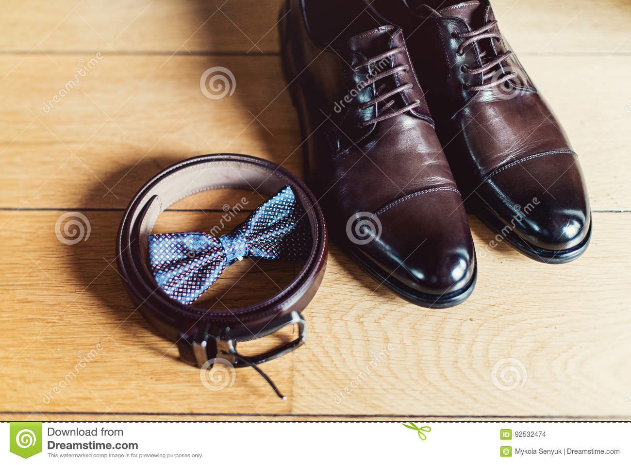 f77b24a9e9a6 Watch Brown bow tie, leather shoes and belt. Grooms wedding morning. Close  up of modern man accessories. Look from above