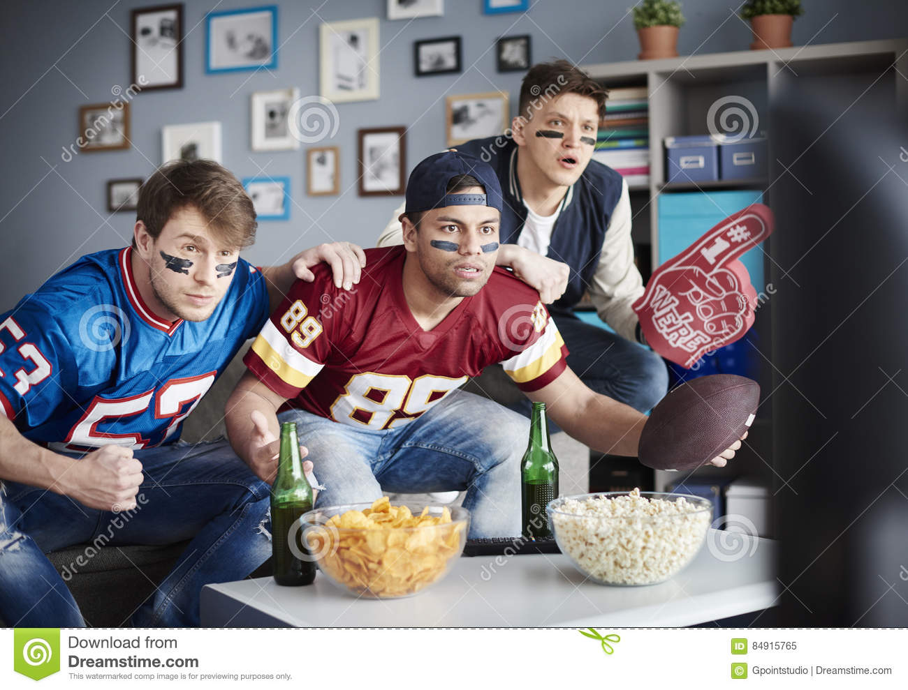 https://thumbs.dreamstime.com/z/watching-football-game-three-adult-guys-anticipation-next-score-84915765.jpg