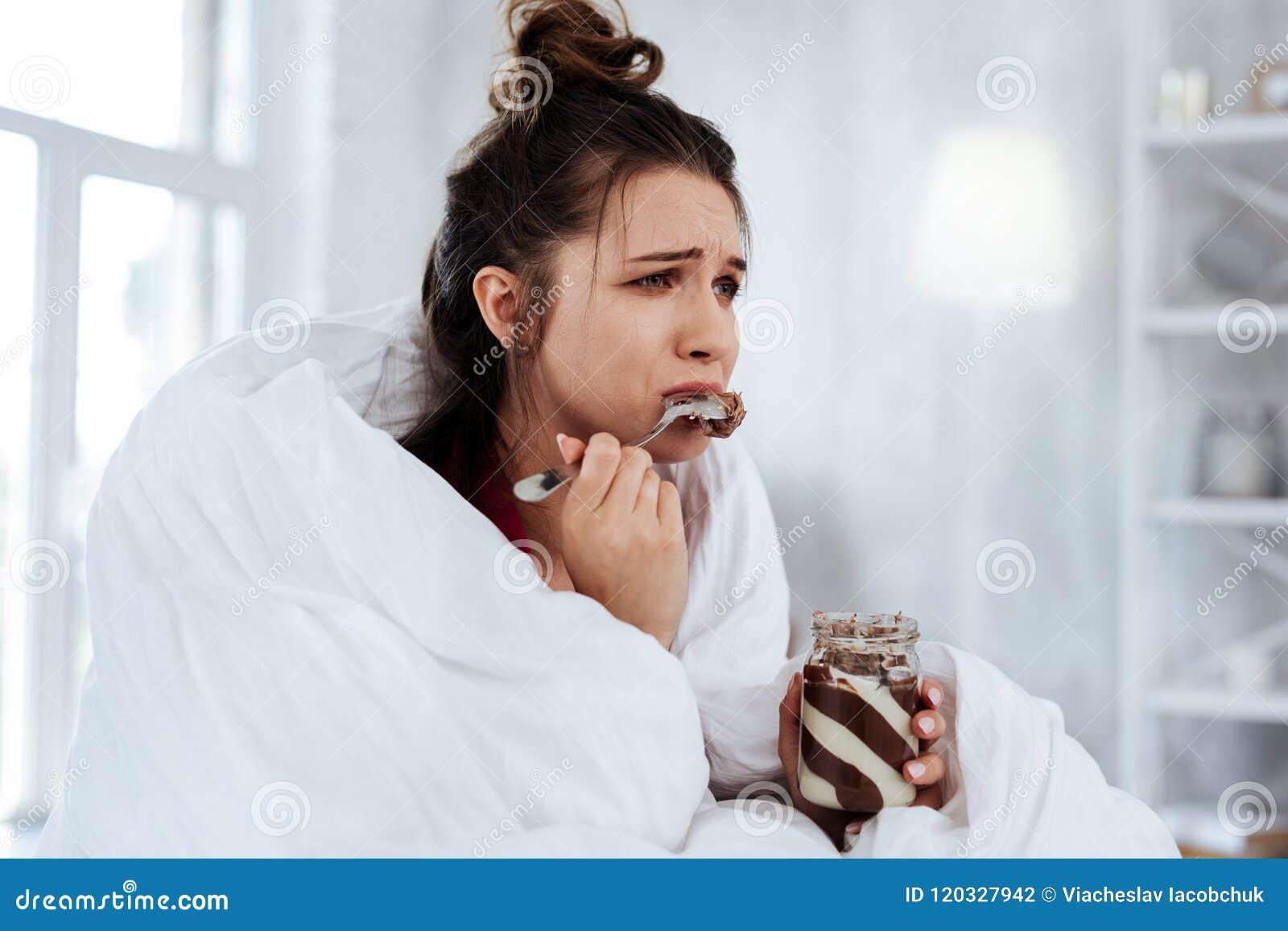 Woman feeling emotional while watching melodrama