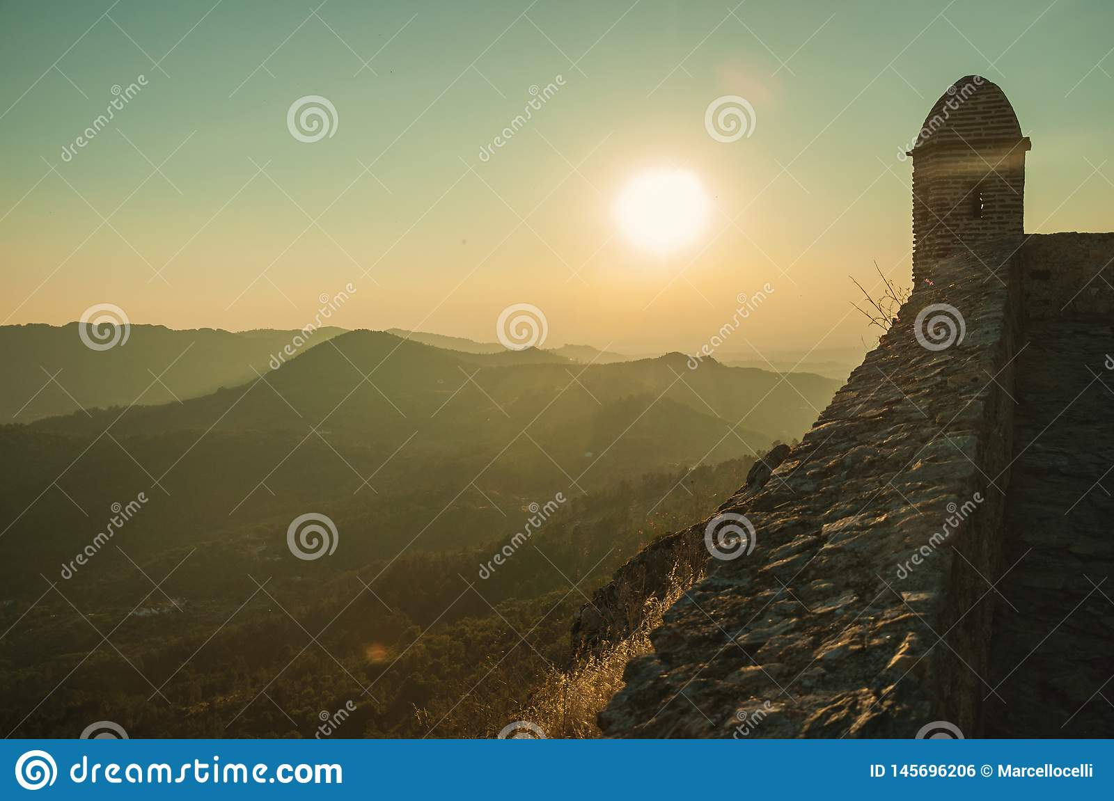 Watchtower and stone wall over rocky cliff in Marvao