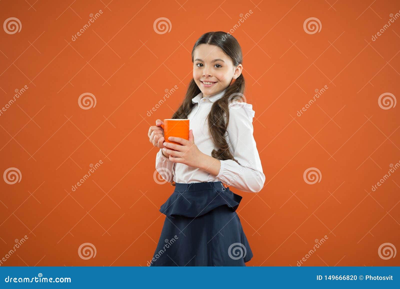 Water balance. Enjoying tea before school classes. Drink enough water. Inspiring drink. Girl drink cocoa or tea