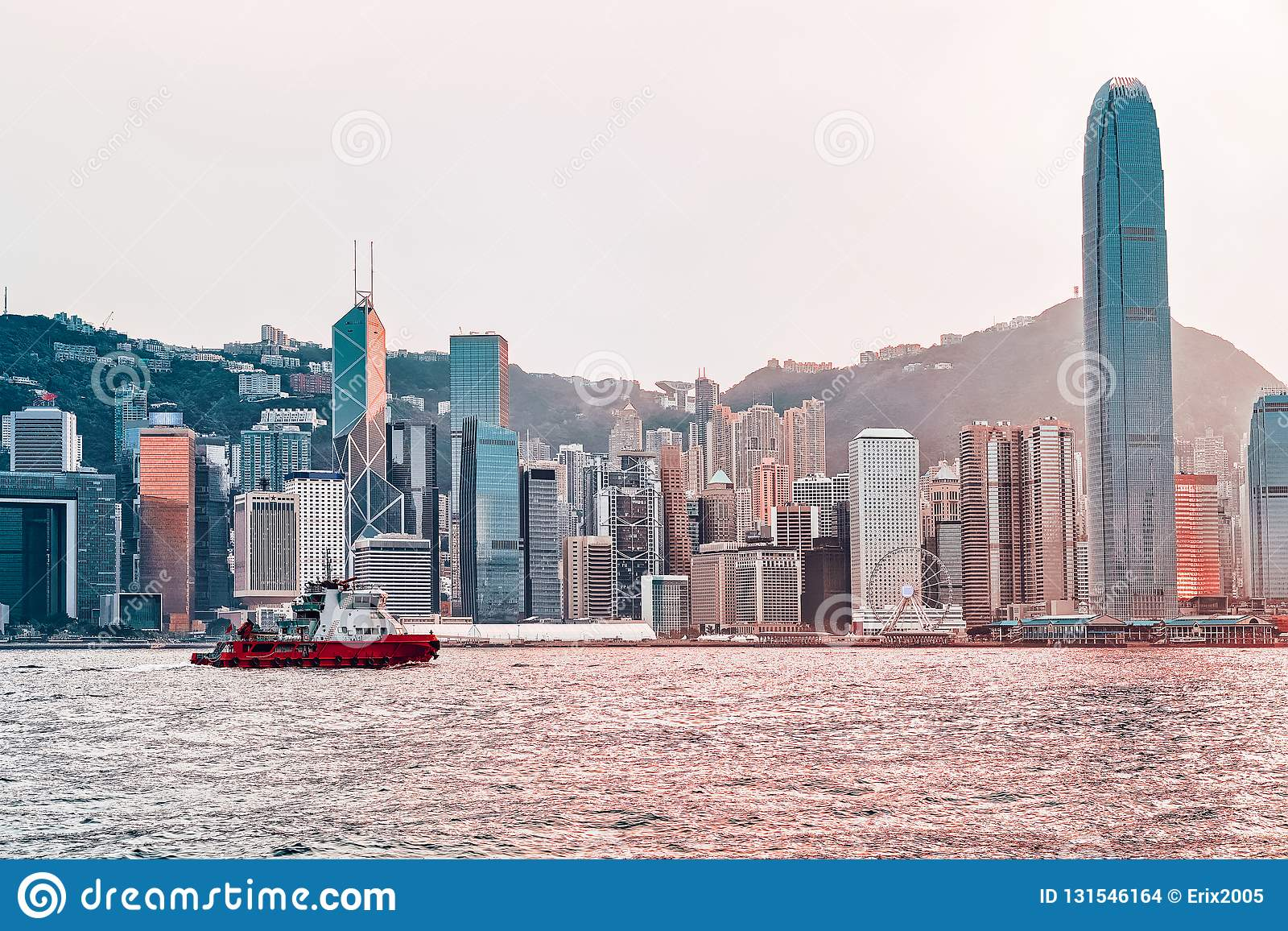 Water boat at Victoria Harbor of Hong Kong at sunset. View from Kowloon on HK Island stock images