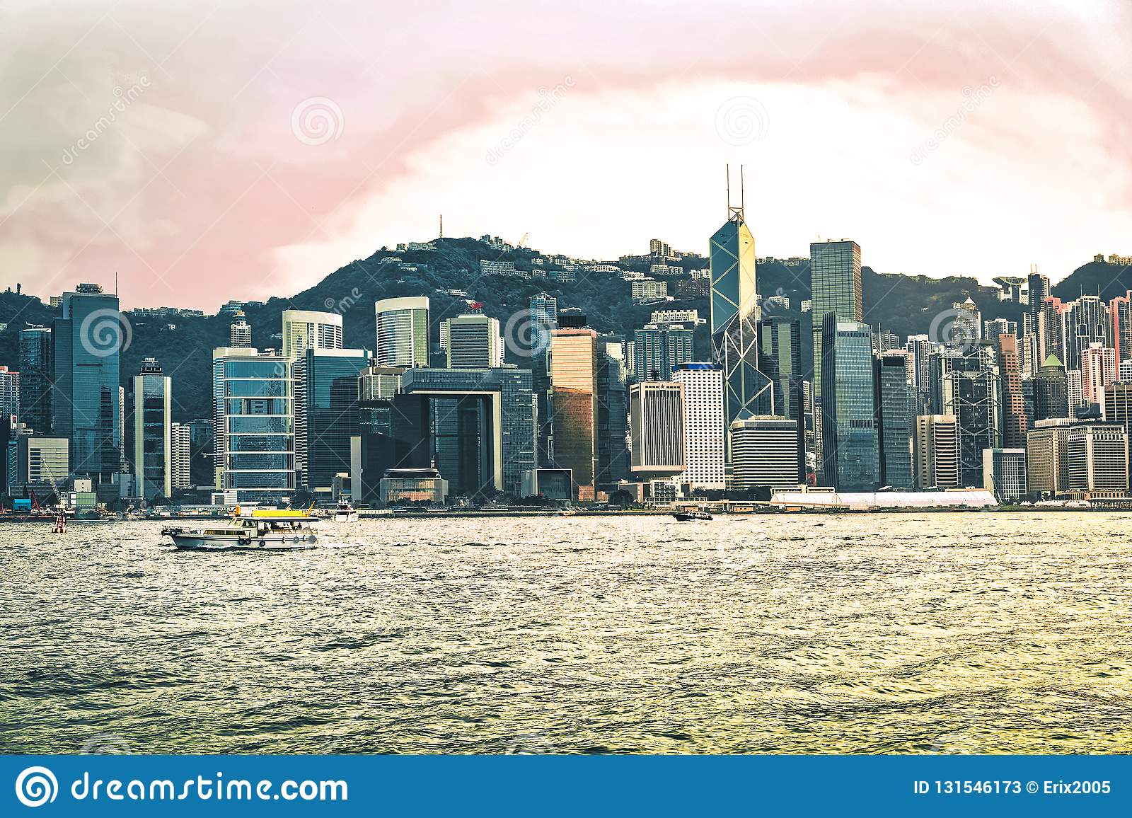 Water boat and Victoria Harbor in Hong Kong at sunset. View from Kowloon on HK Island stock photos
