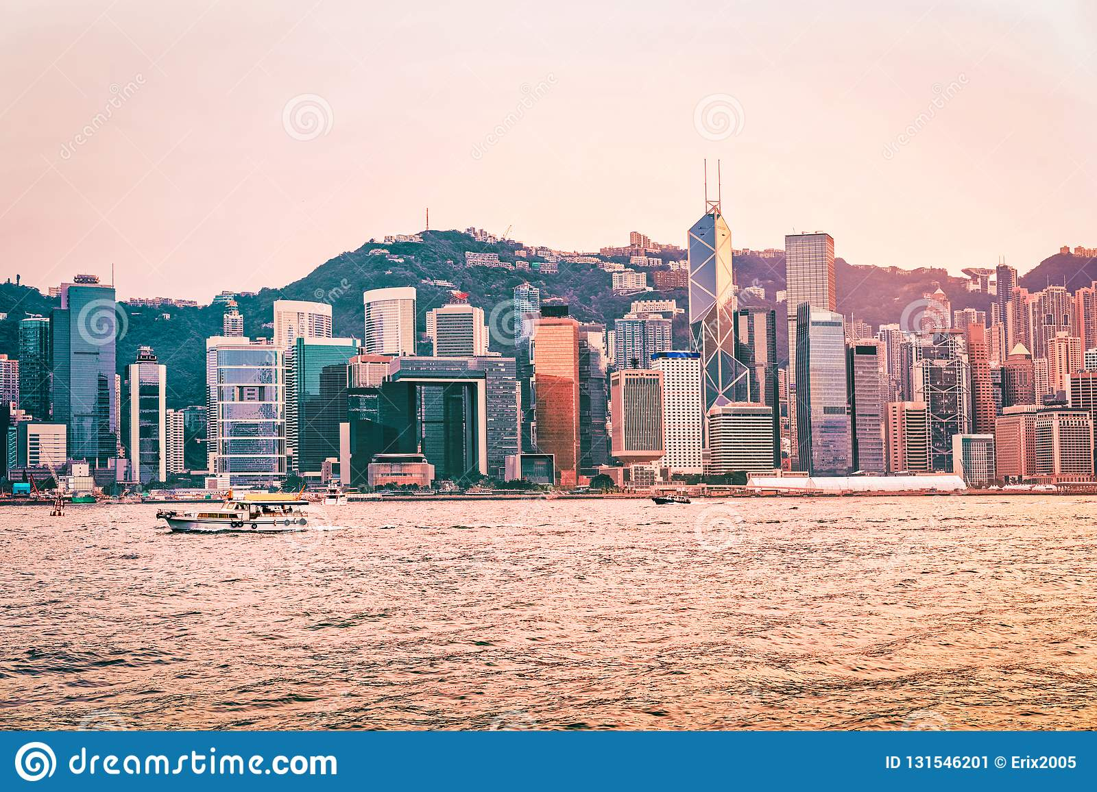 Water boat and Victoria Harbor in Hong Kong at sunset. View from Kowloon on HK Island stock image
