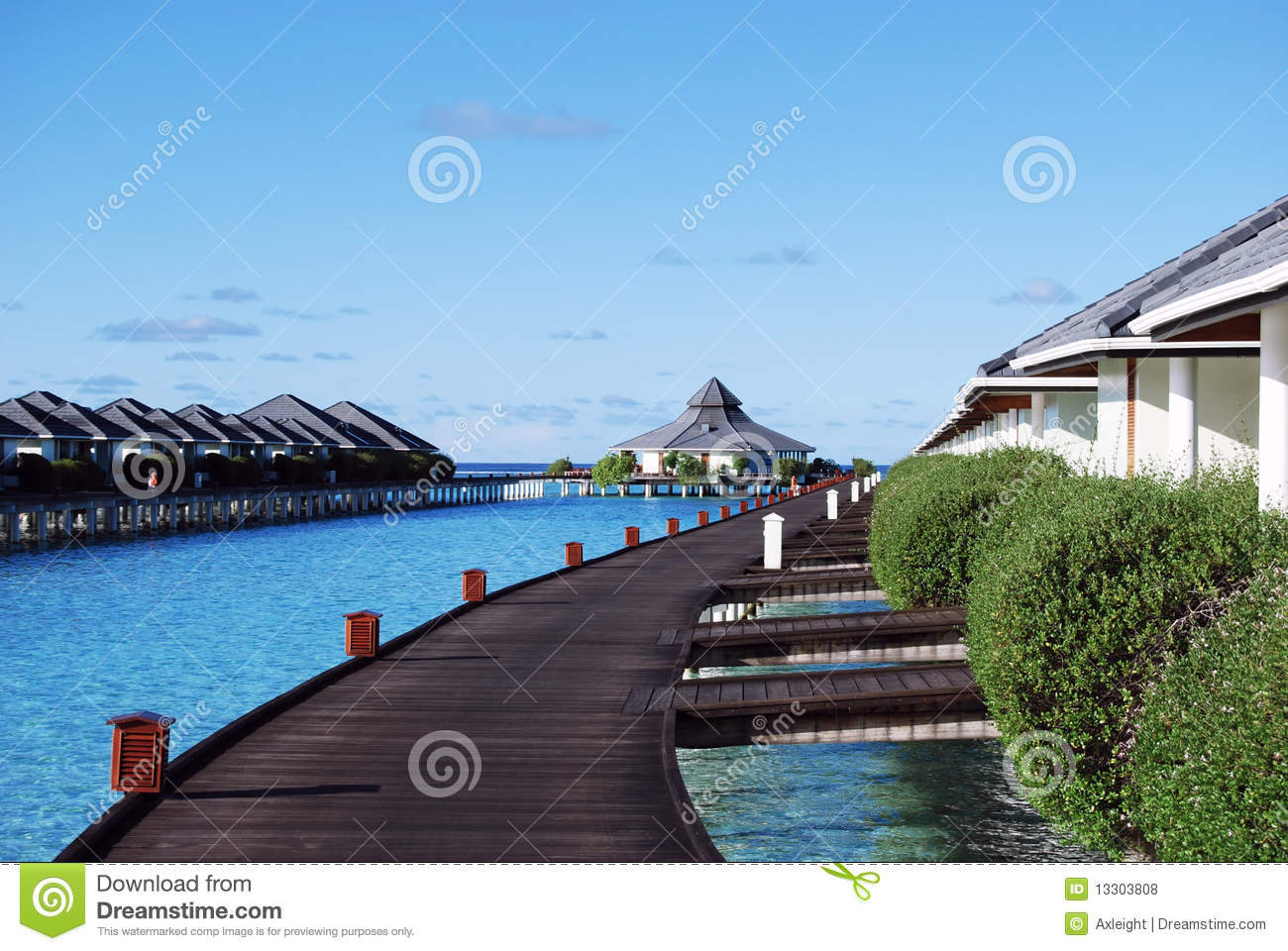 Water bungalows and blue ocean and sunny sky