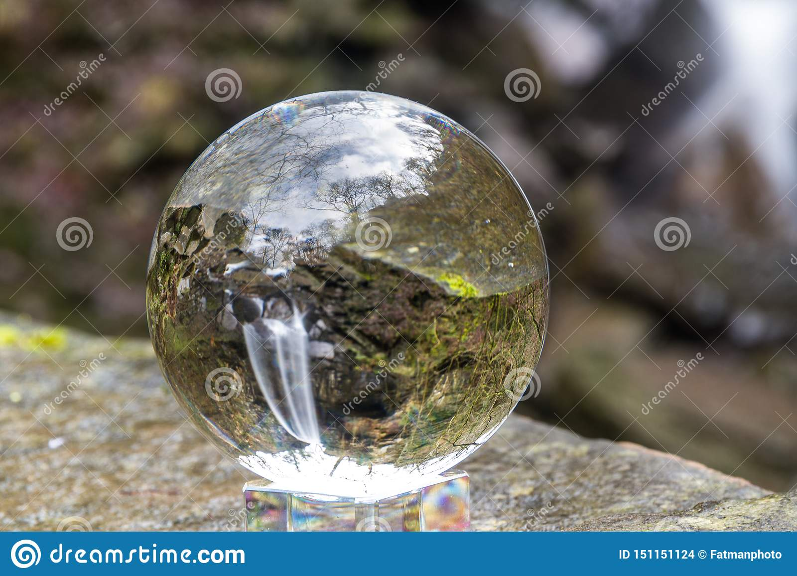 Water cascading down beautiful waterfall, Melincourt, through crystal ball, landscape