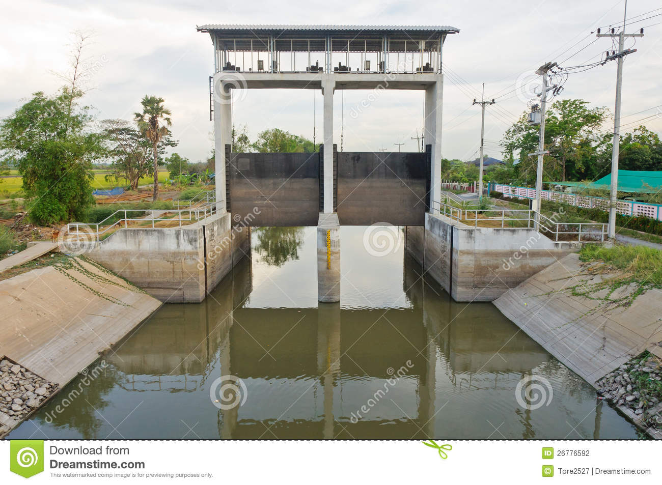Water And Dam Gate In An Irrigation Canal Stock Photo