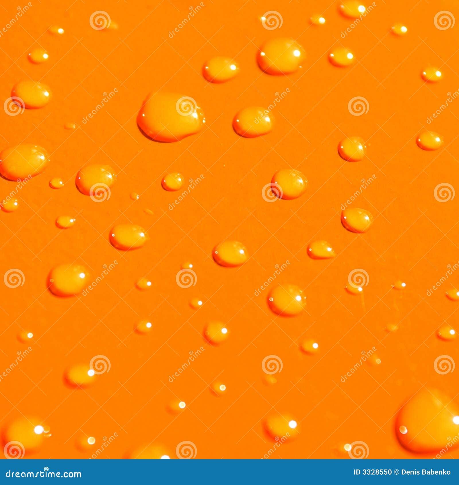 Water drops on orange metal ba