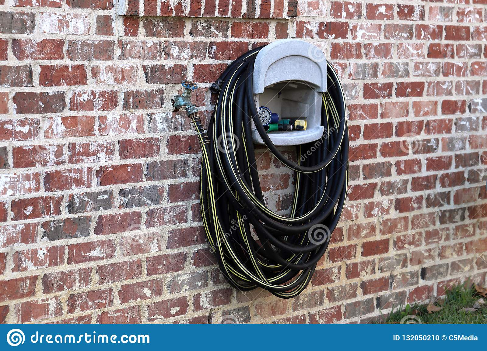 Water Faucet And Hose On Side Of Brick House Stock Photo ...