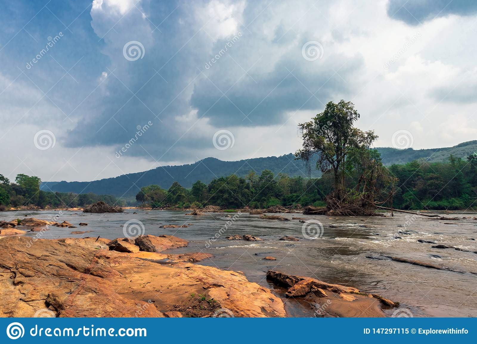 Water flow of athirapally waterfall with mountain