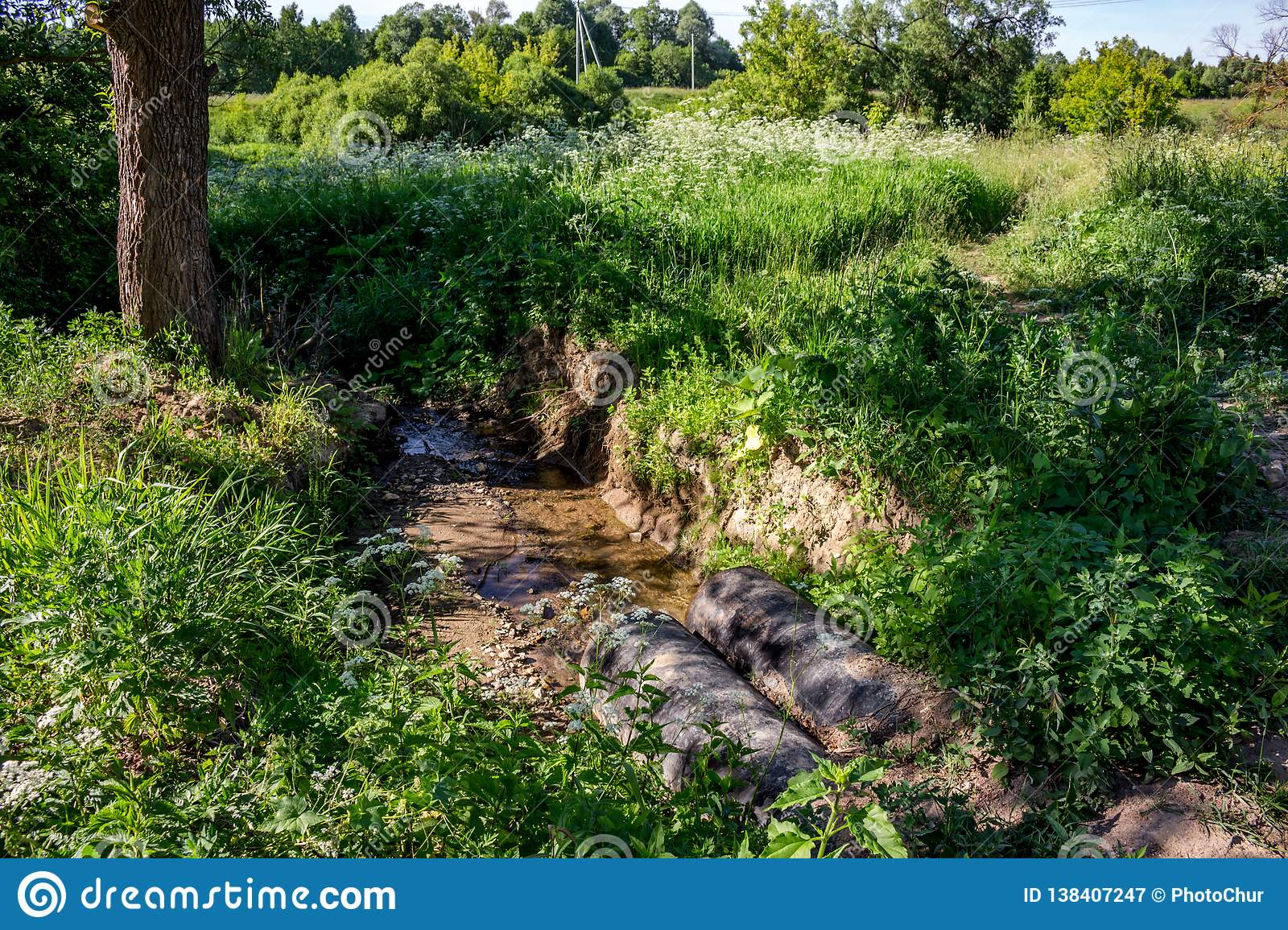 Water Flow Through Water Pipes In Nature Stock Image - Image