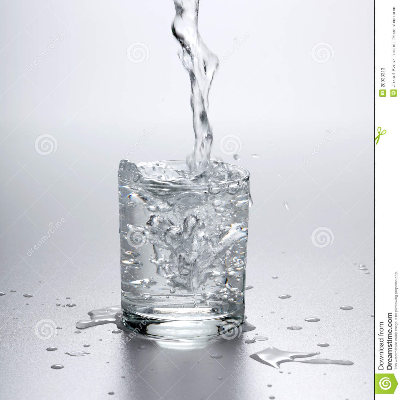 Water Flowing Into Full Glass Stock Image Of