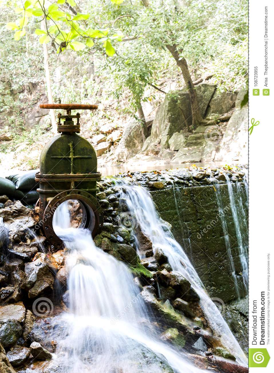 The Water Flowing From The Steel Drain Into The Brook Of ...