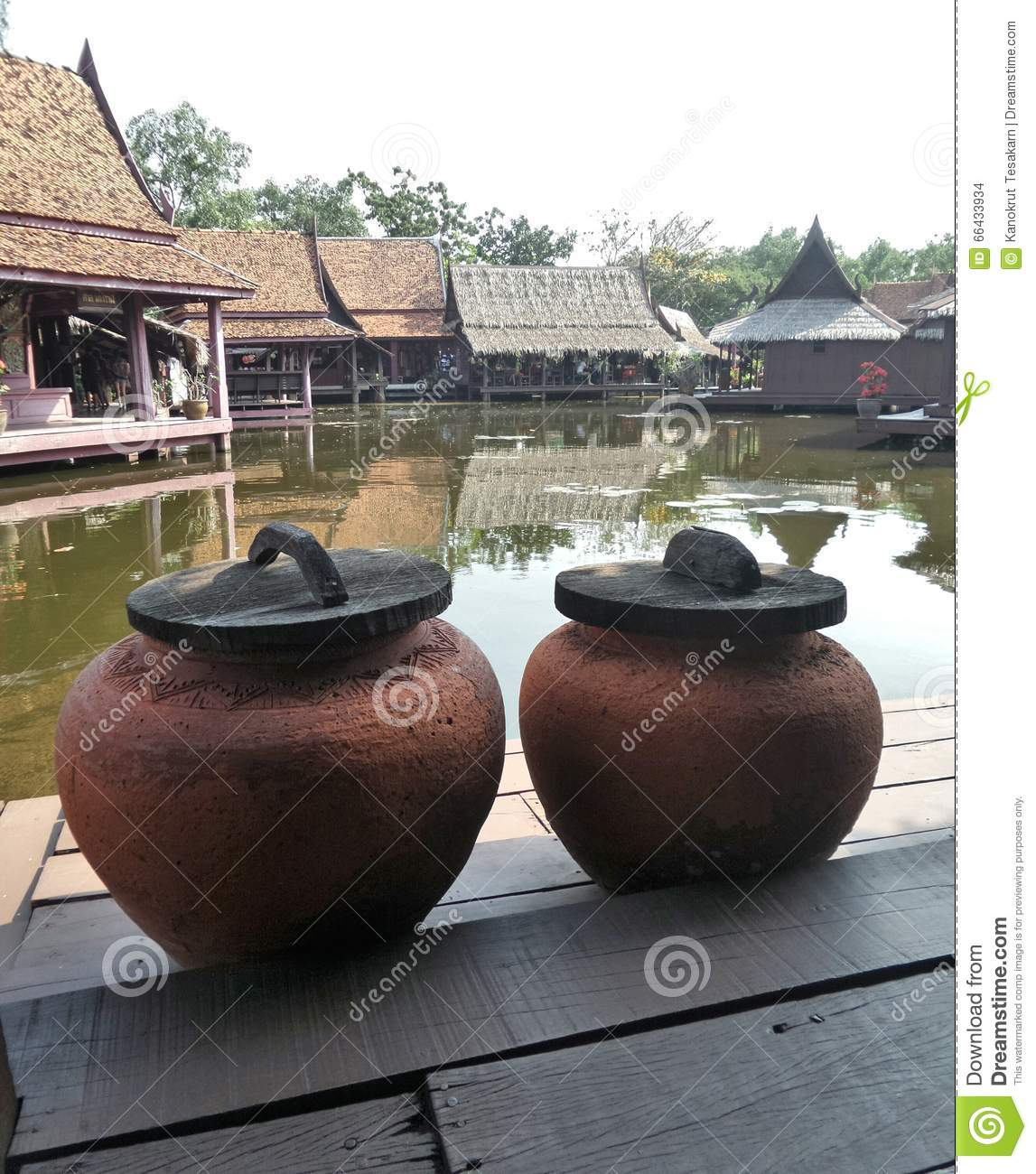 Cover Terrace: Water Jar With Wooden Cover On Terrace Stock Photo