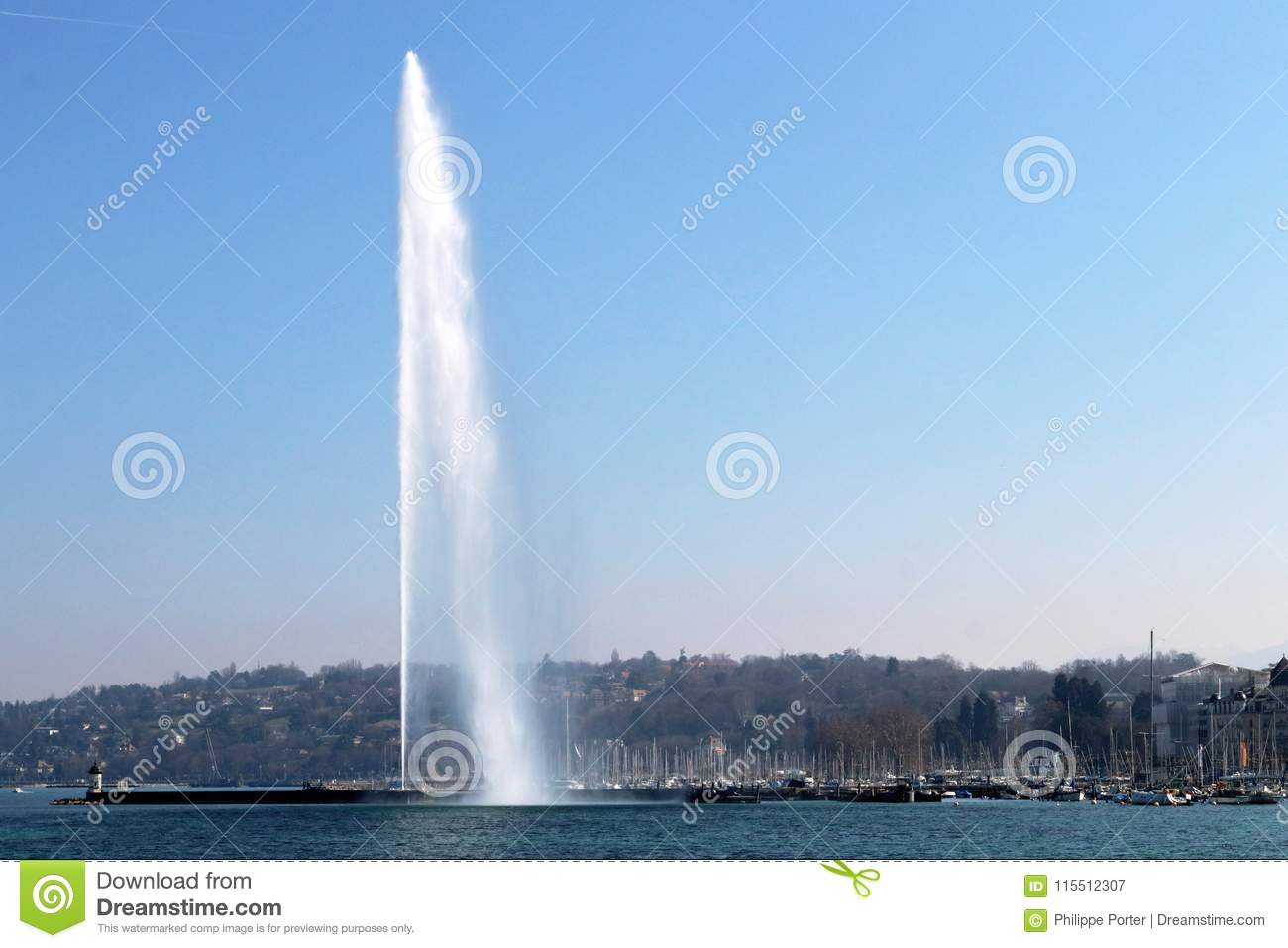 Water jet in Geneva cityscape Switzerland. City, lake et mountains