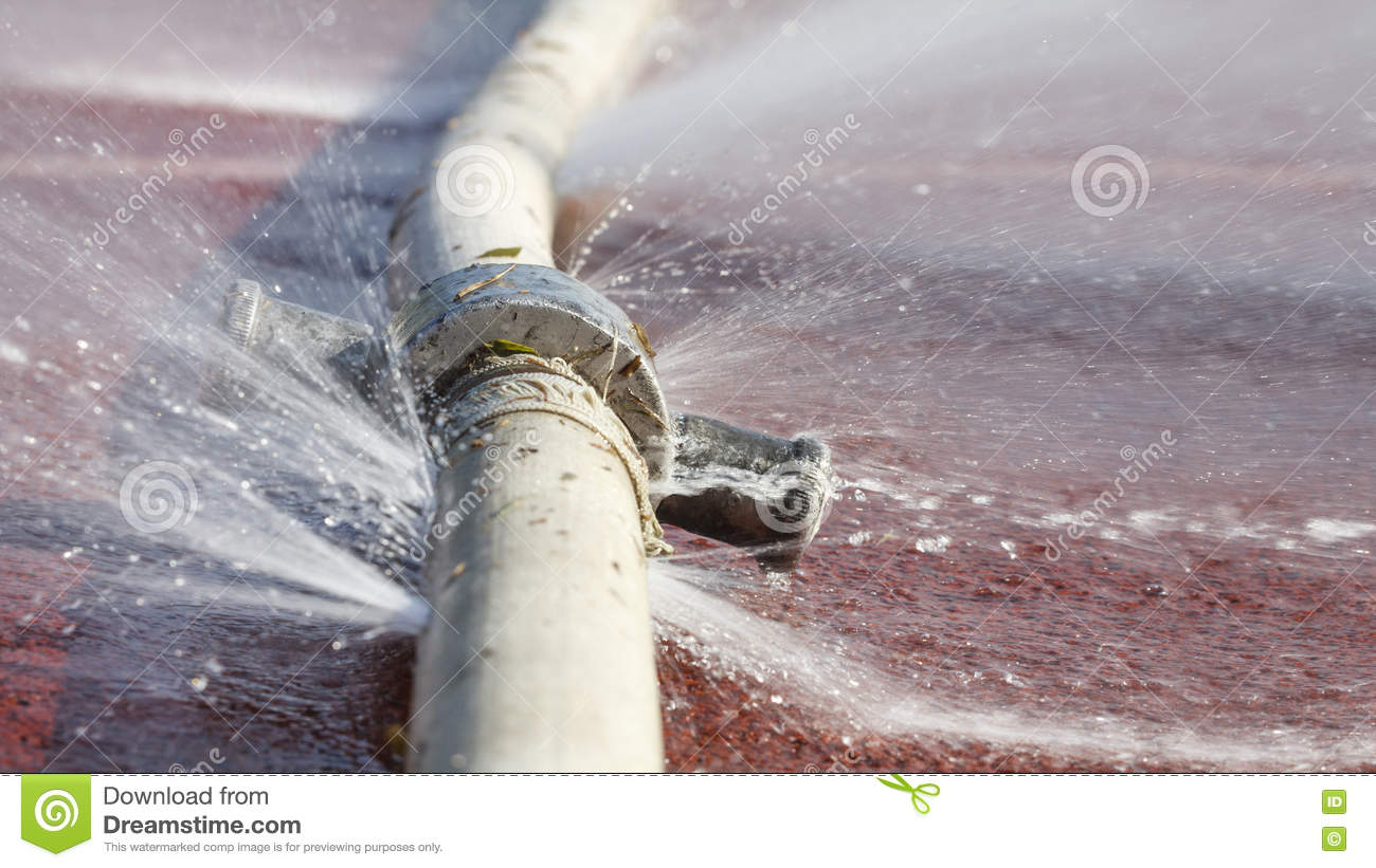Water Leaking From Hole In A Hose Royalty Free Stock