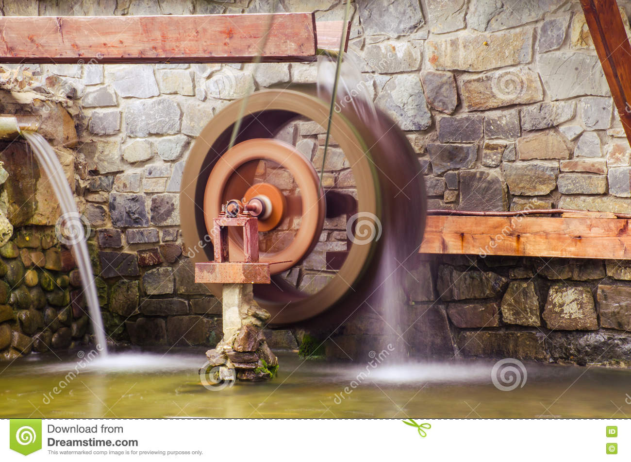 Water Building Material : Water mill stone in stony wall from nature material