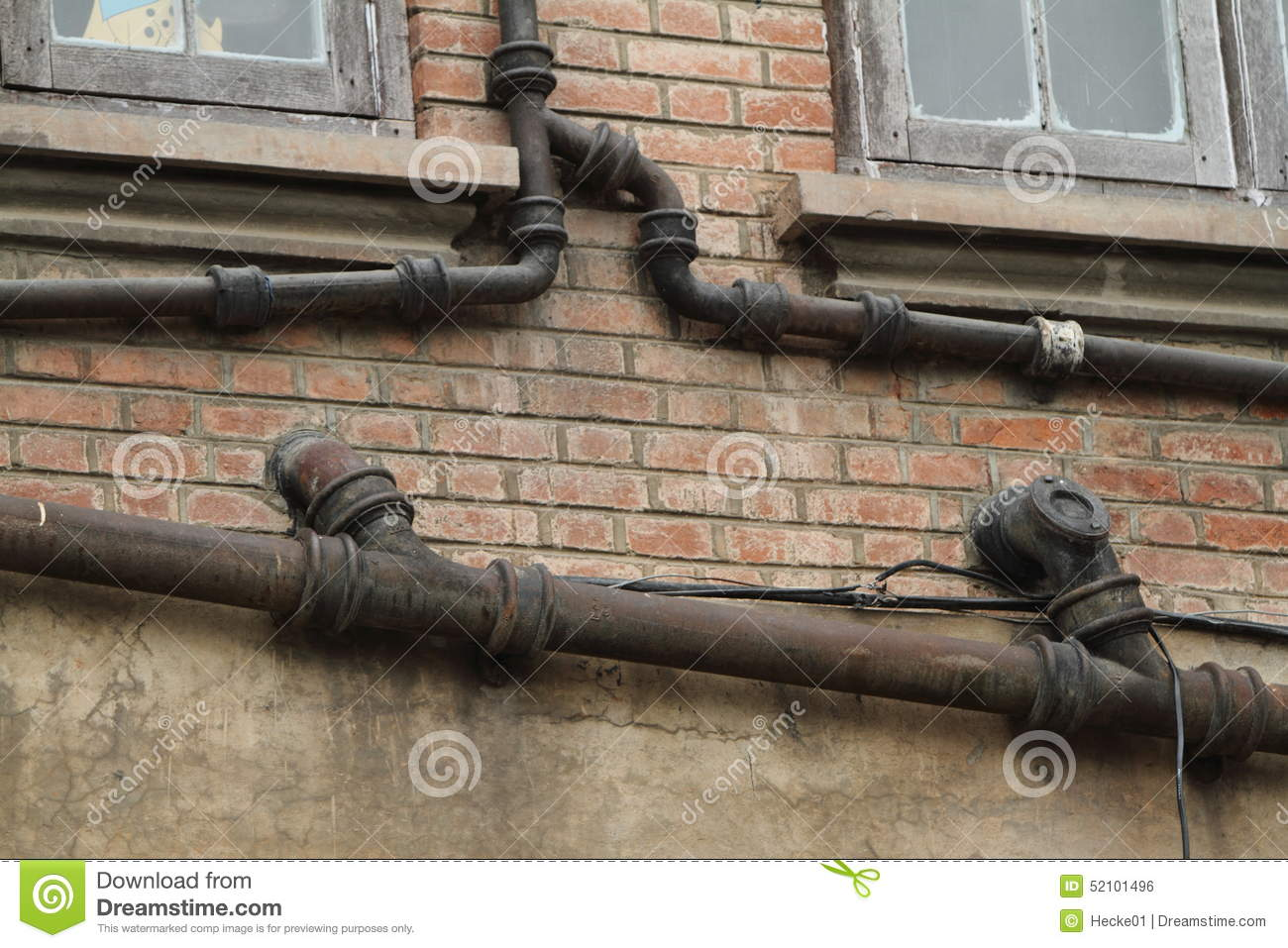 Water pipes on old building stock photo image 52101496 for What are old plumbing pipes made of