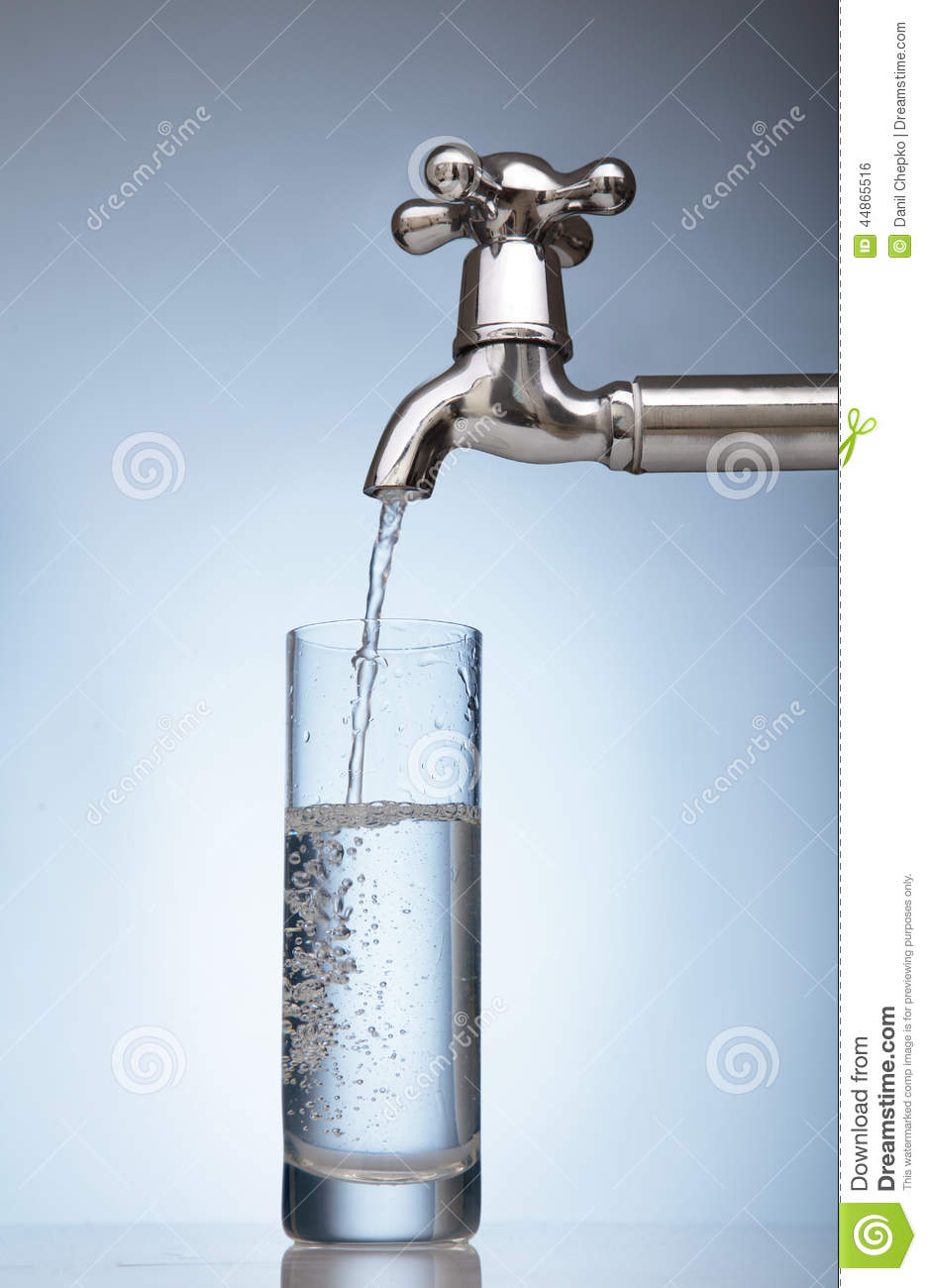 Water Is Poured Into A Glass From The Tap Stock Photo