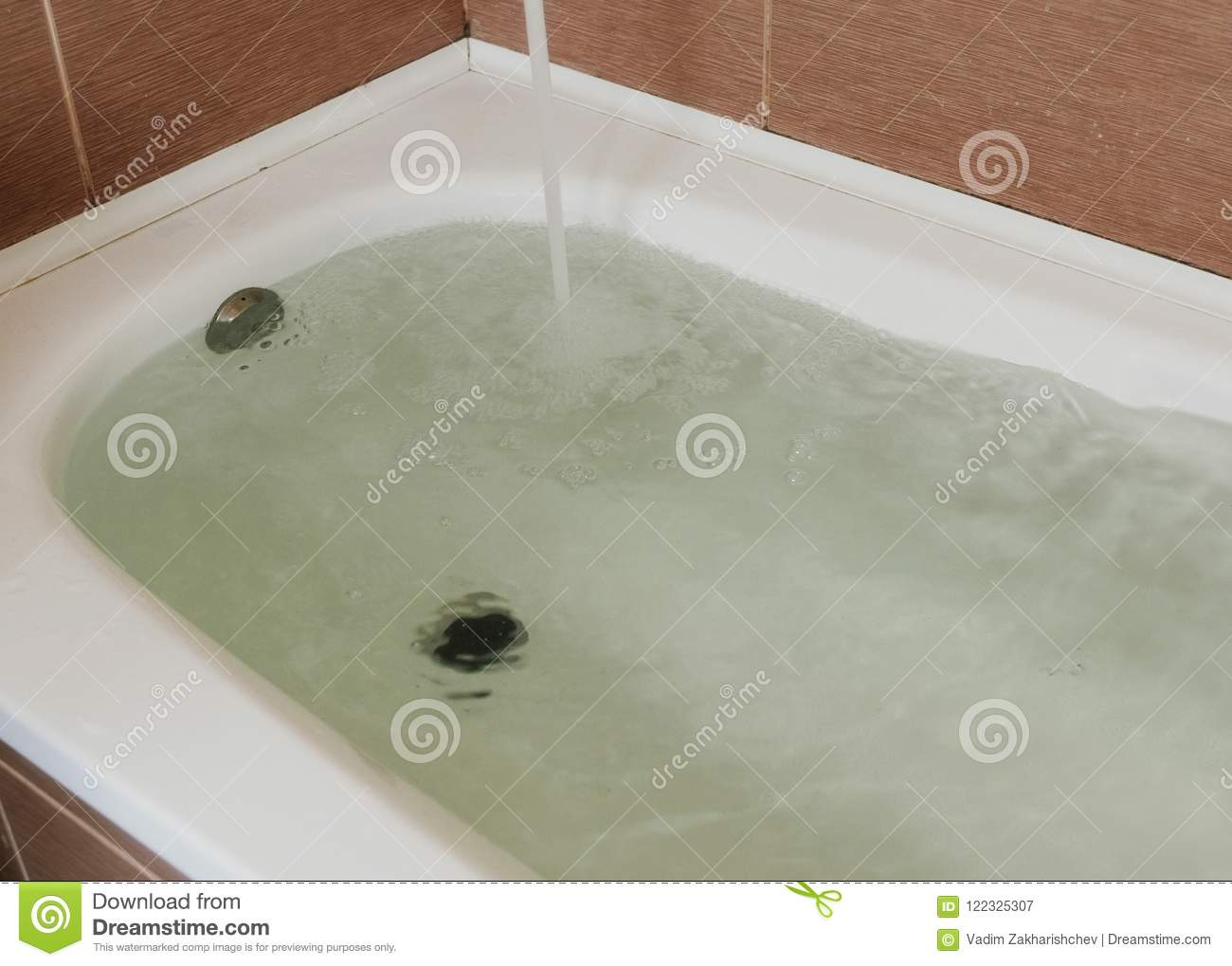 Water Poured Into The Tub. Full Bath. Close Up. Stock Image - Image ...