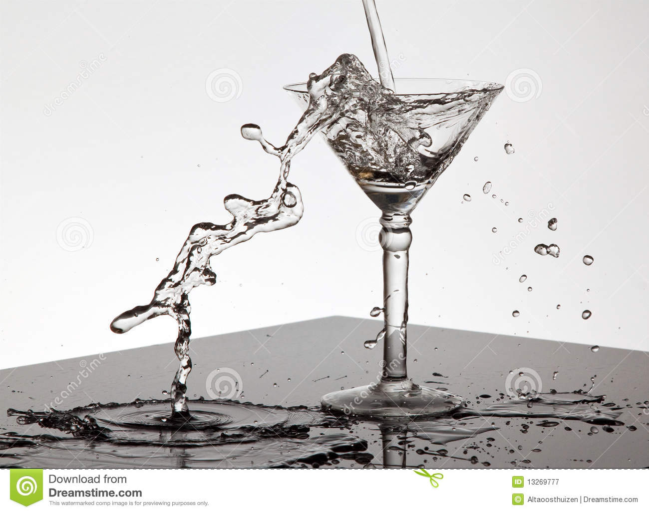 water pouring into a martini glass royalty free stock