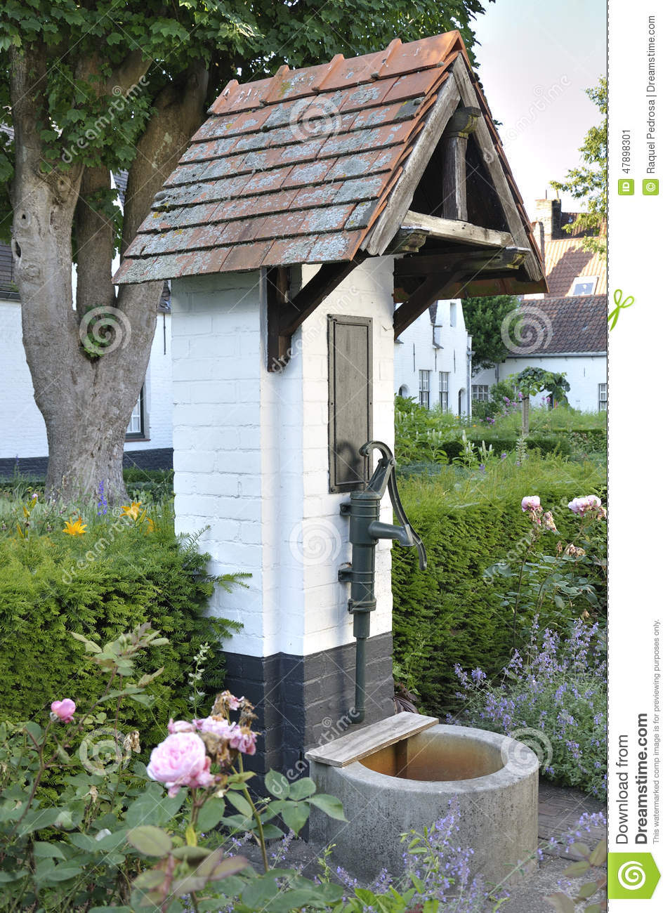water pump in a garden stock image image of brick bucket 47898301. Black Bedroom Furniture Sets. Home Design Ideas