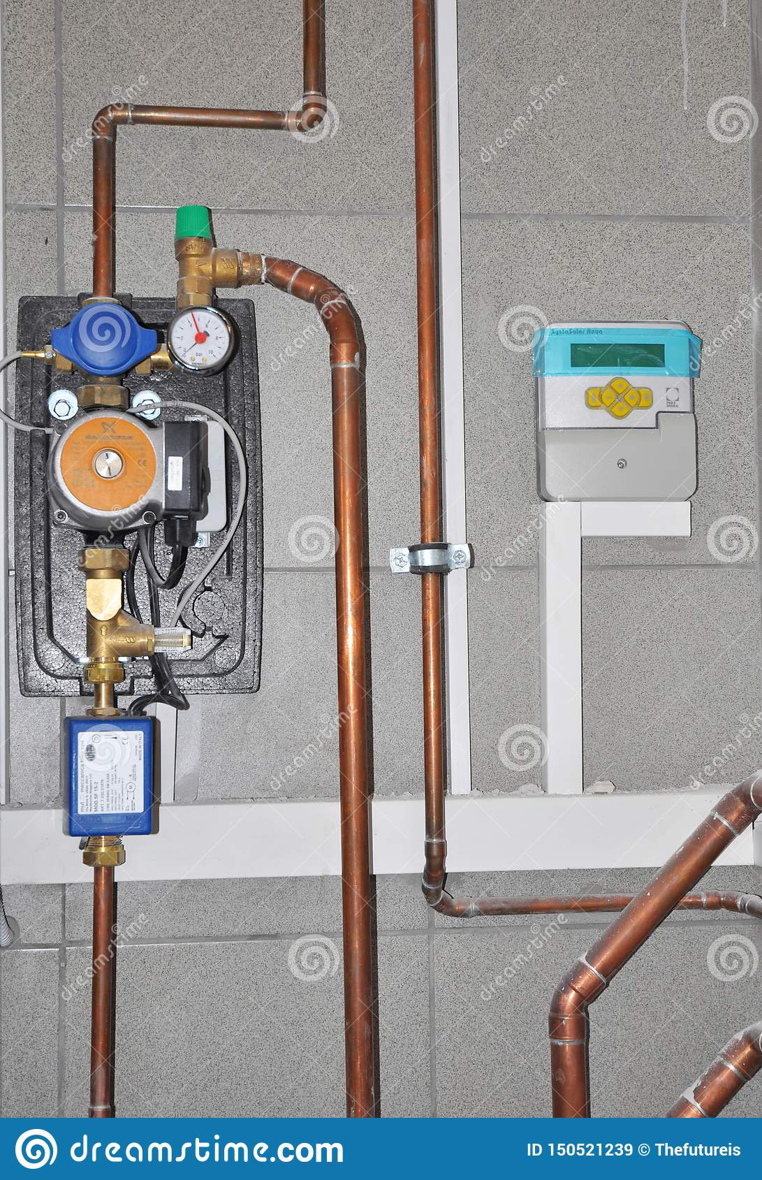 Water pump for house heater boiler with copper pipes. Natural gas boiler and solar water heater system in house room
