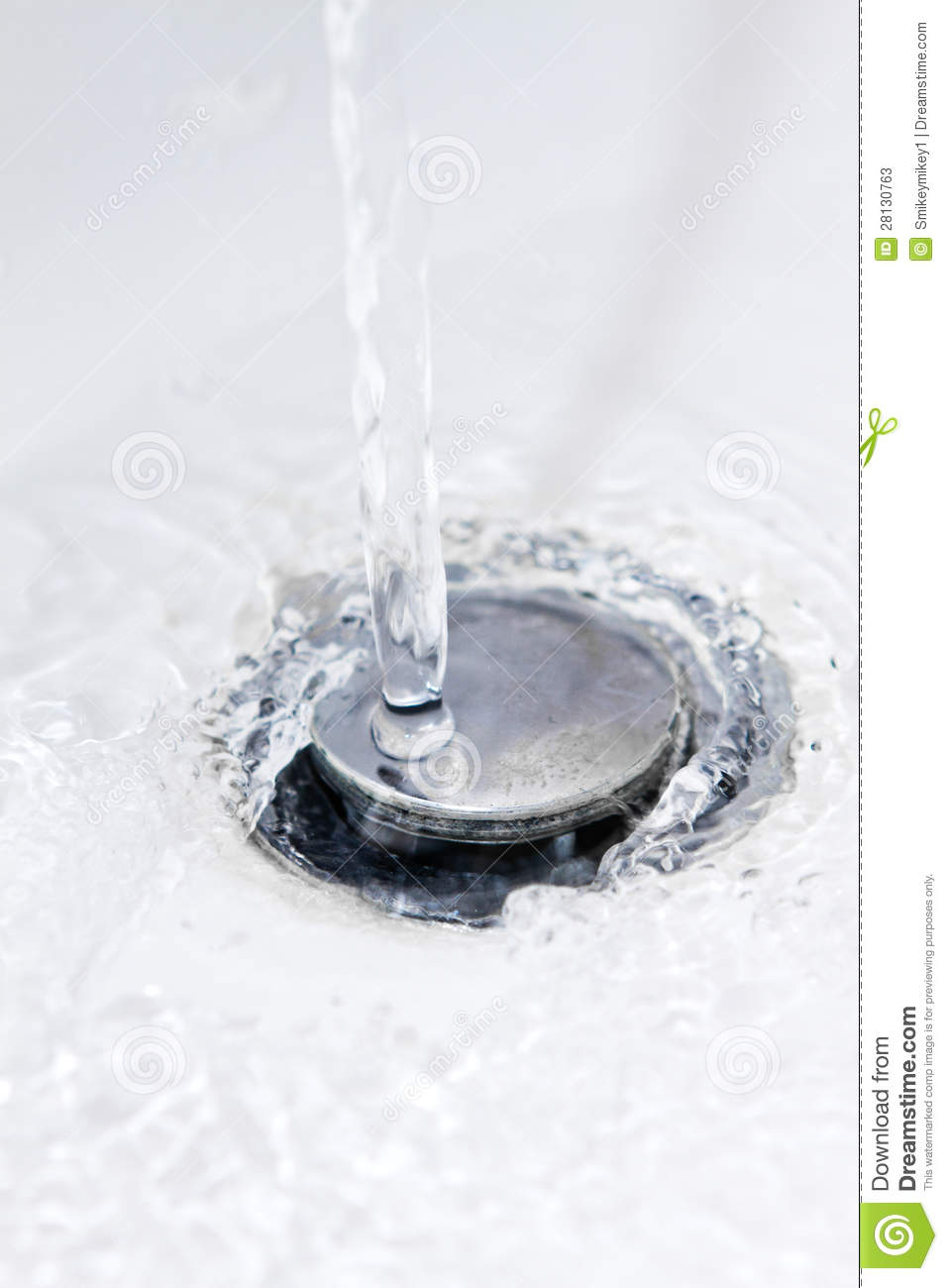 Water Running Down A Bathroom Sink Plug Hole Stock Photos