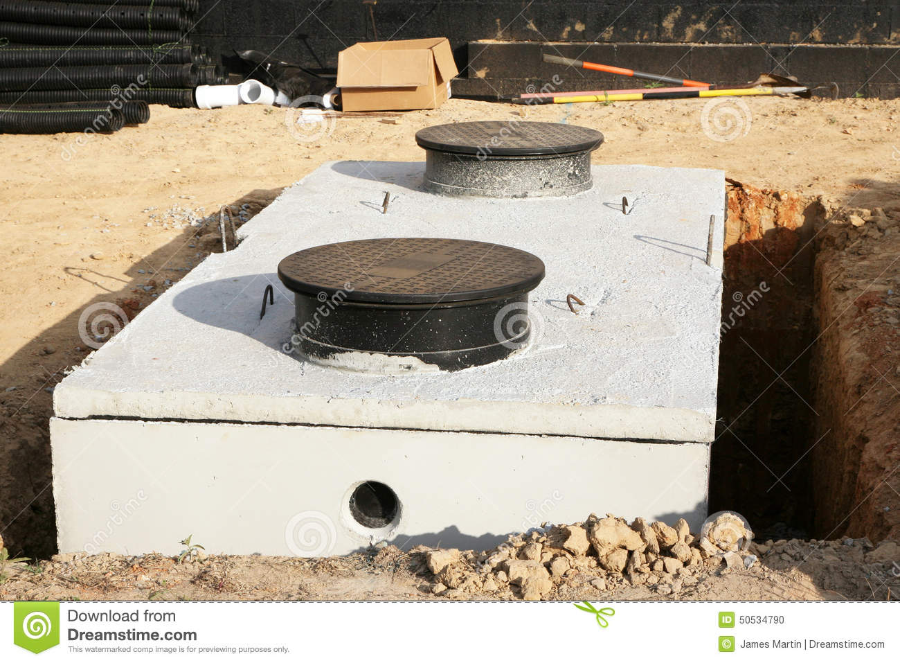 Underground Water Tank Construction : Water or septic tank installation stock photo image of