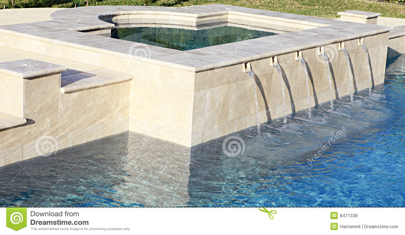 Water Spilling From Spa Into Luxury Swimming Pool Royalty