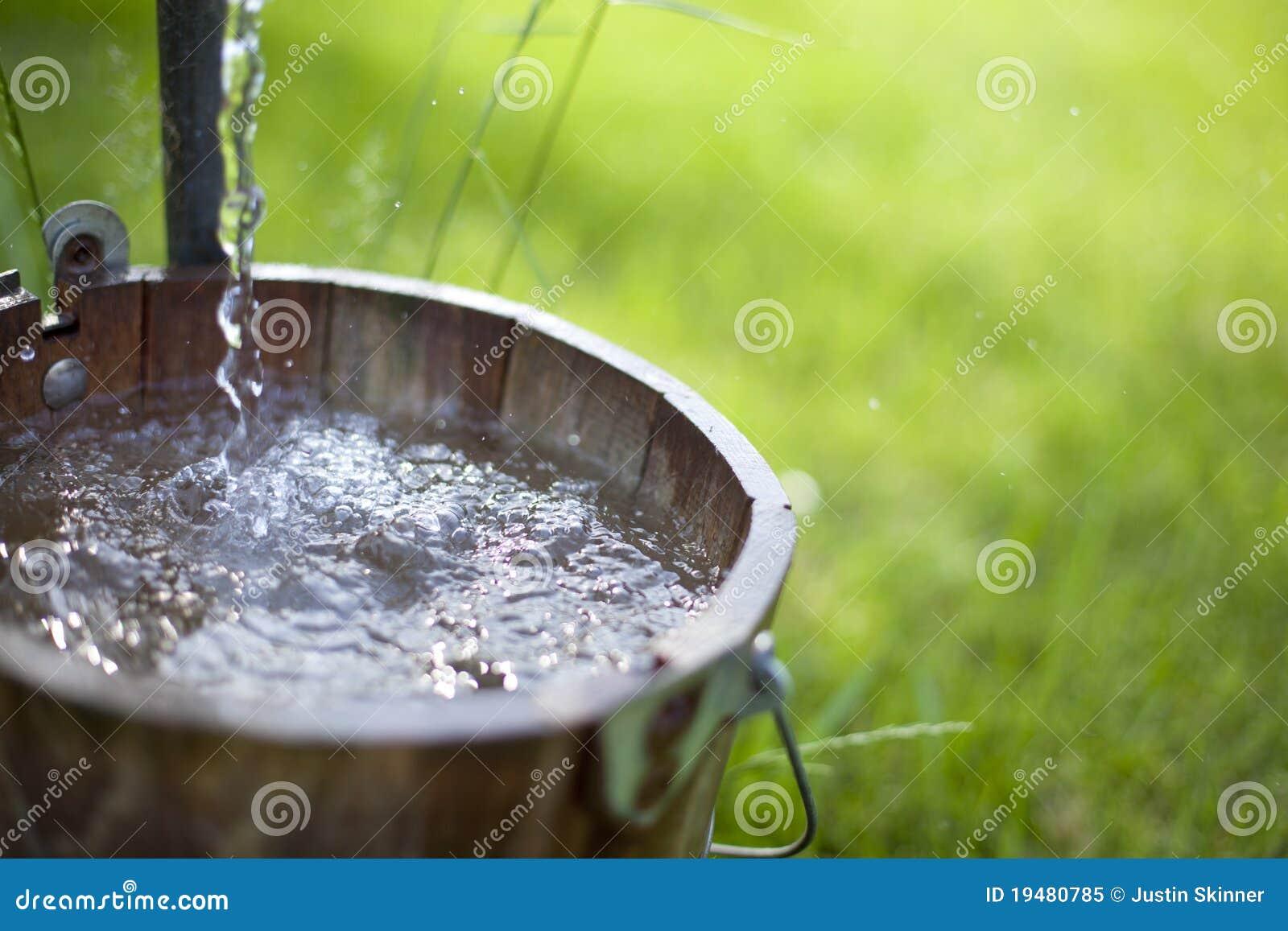 Pump It Up Prices >> Water Splashing in Bucket stock image. Image of running ...