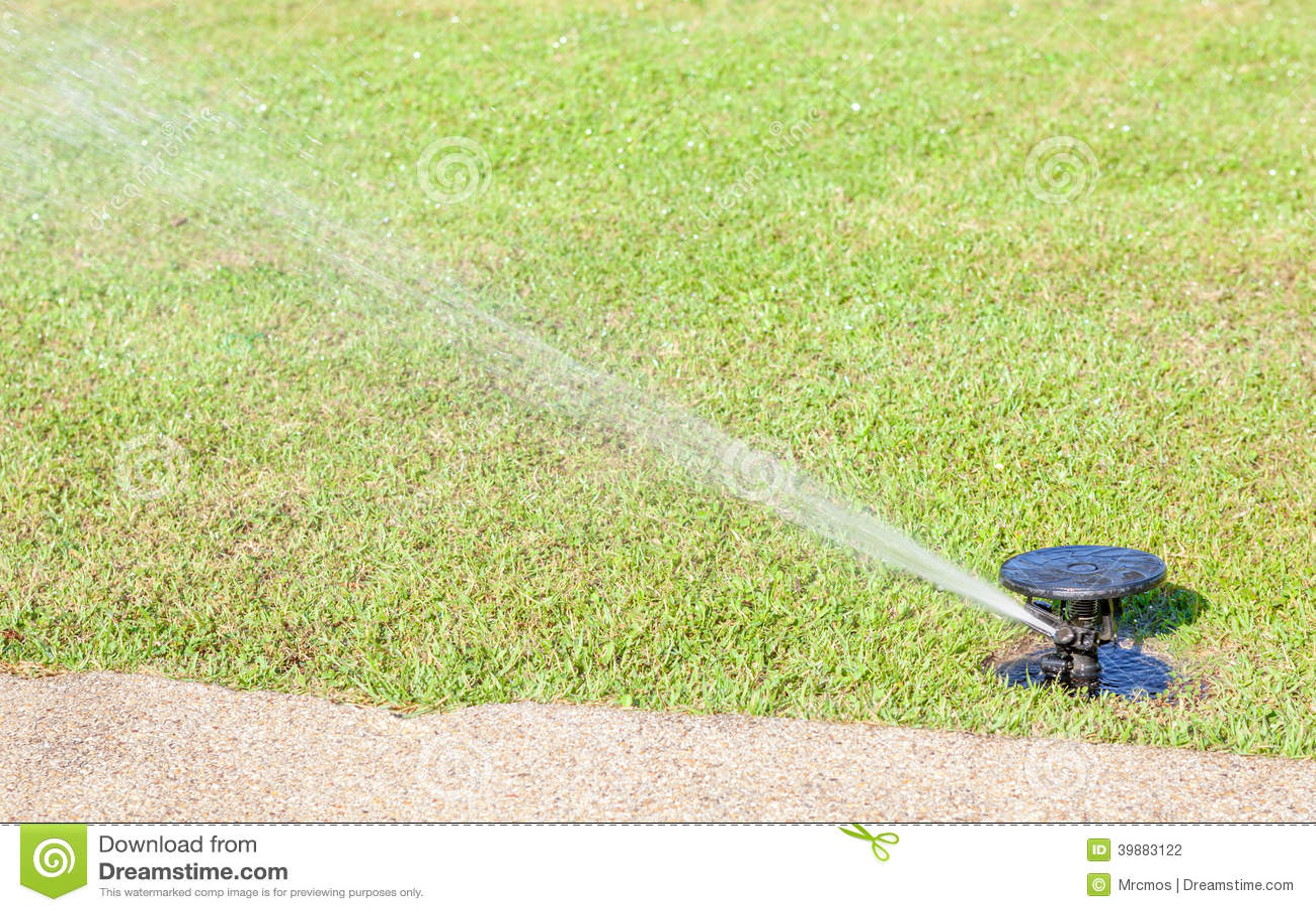 Sprinkler Watering Field Of Green Grass Royalty Free Stock